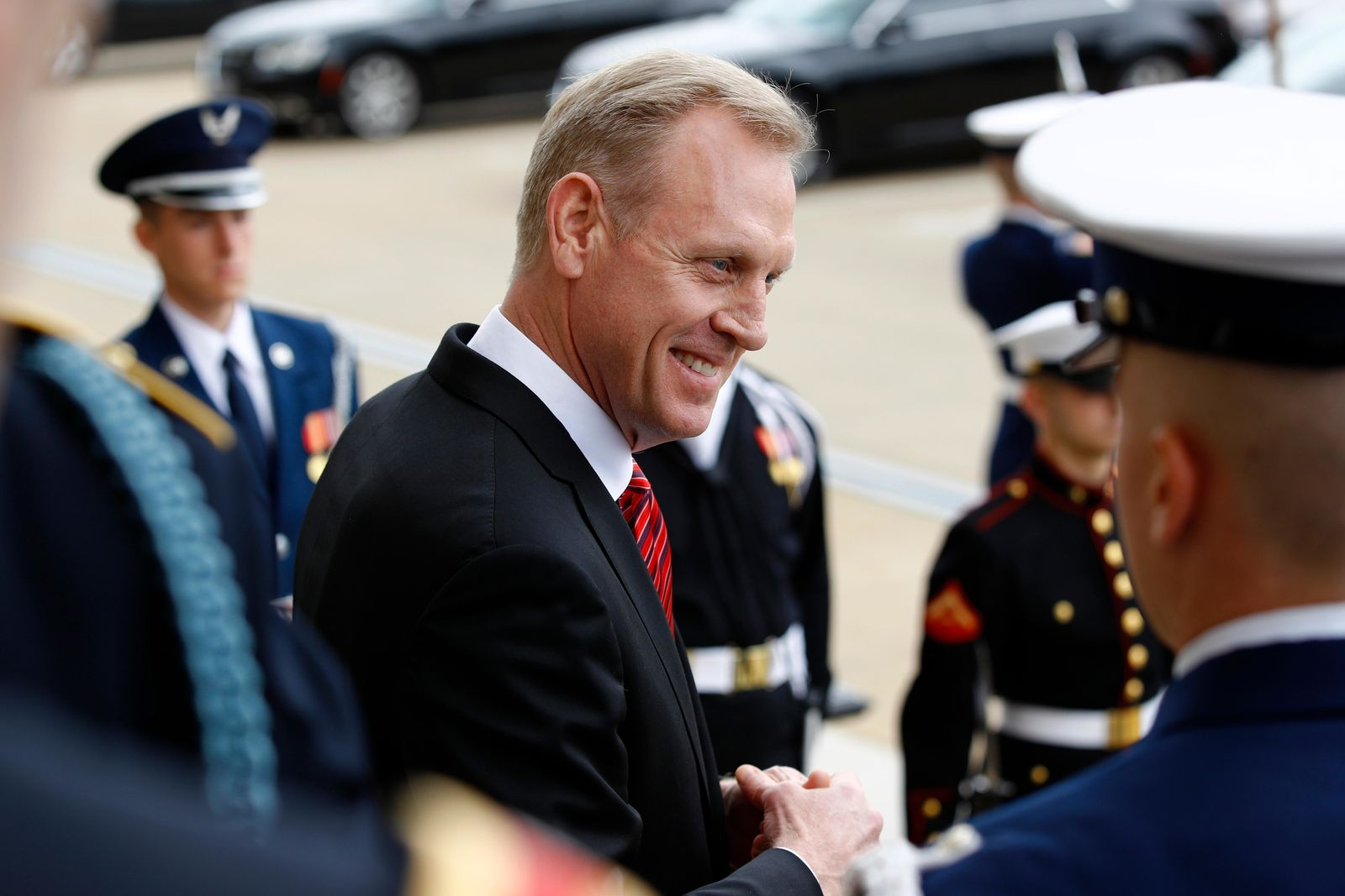 Acting Defense Secretary Patrick Shanahan speaks with reporters before an arrival ceremony for Japan's Defense Minister Takeshi Iwaya at the Pentagon, Friday, April 19, 2019, in Washington. (AP Photo/Patrick Semansky)