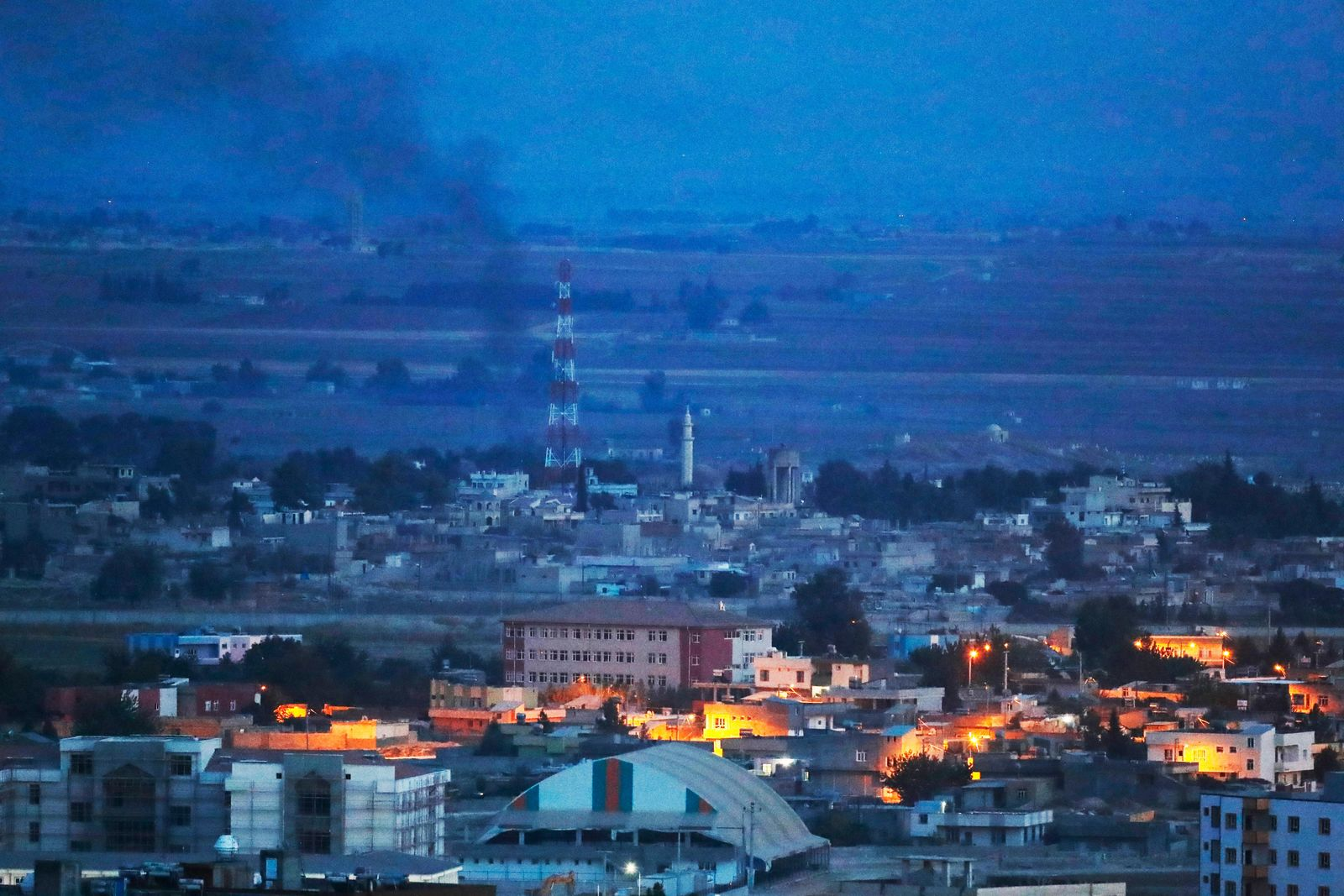 In this photo taken from the Turkish side of the border between Turkey and Syria, in Ceylanpinar, Sanliurfa province, southeastern Turkey, smoke billows from targets in Ras al-Ayn, Syria, caused by bombardment by Turkish forces, Tuesday, Oct. 15, 2019.(AP Photo/Lefteris Pitarakis)