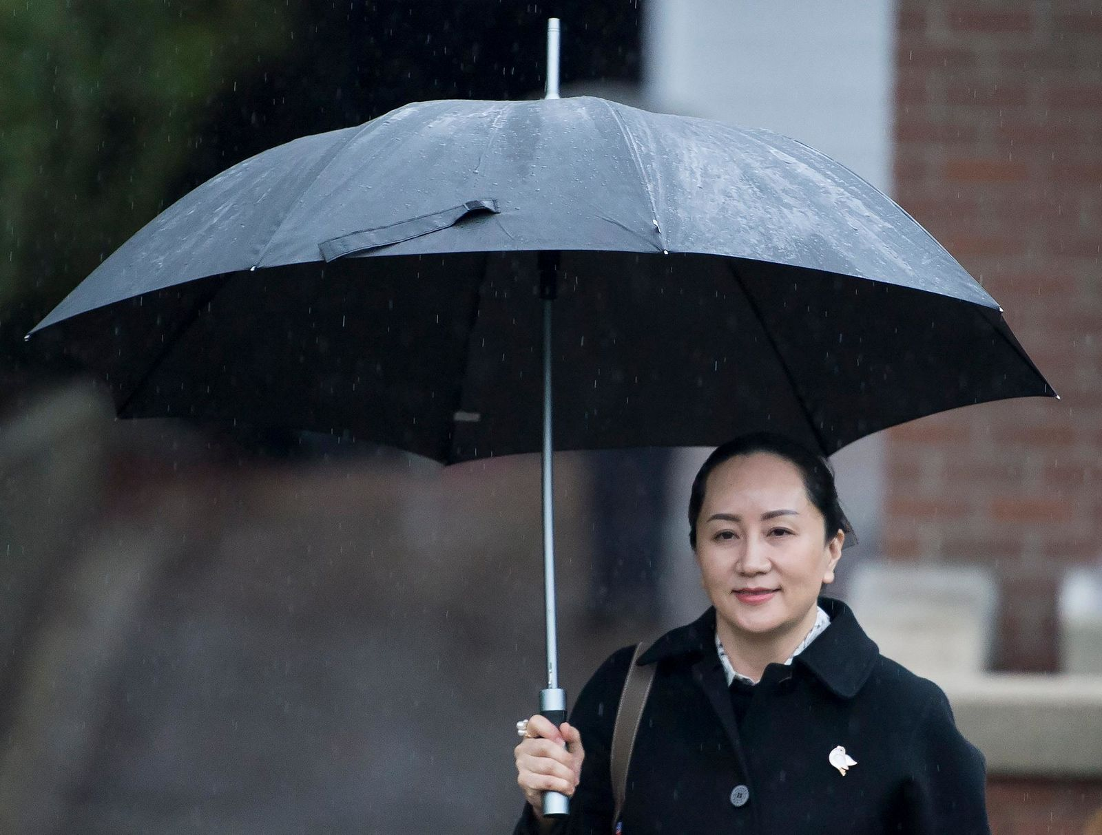 Meng Wanzhou, chief financial officer of Huawei, leaves her home to go to B.C. Supreme Court in Vancouver, Thursday, January, 23, 2020. (Jonathan Hayward/The Canadian Press via AP)