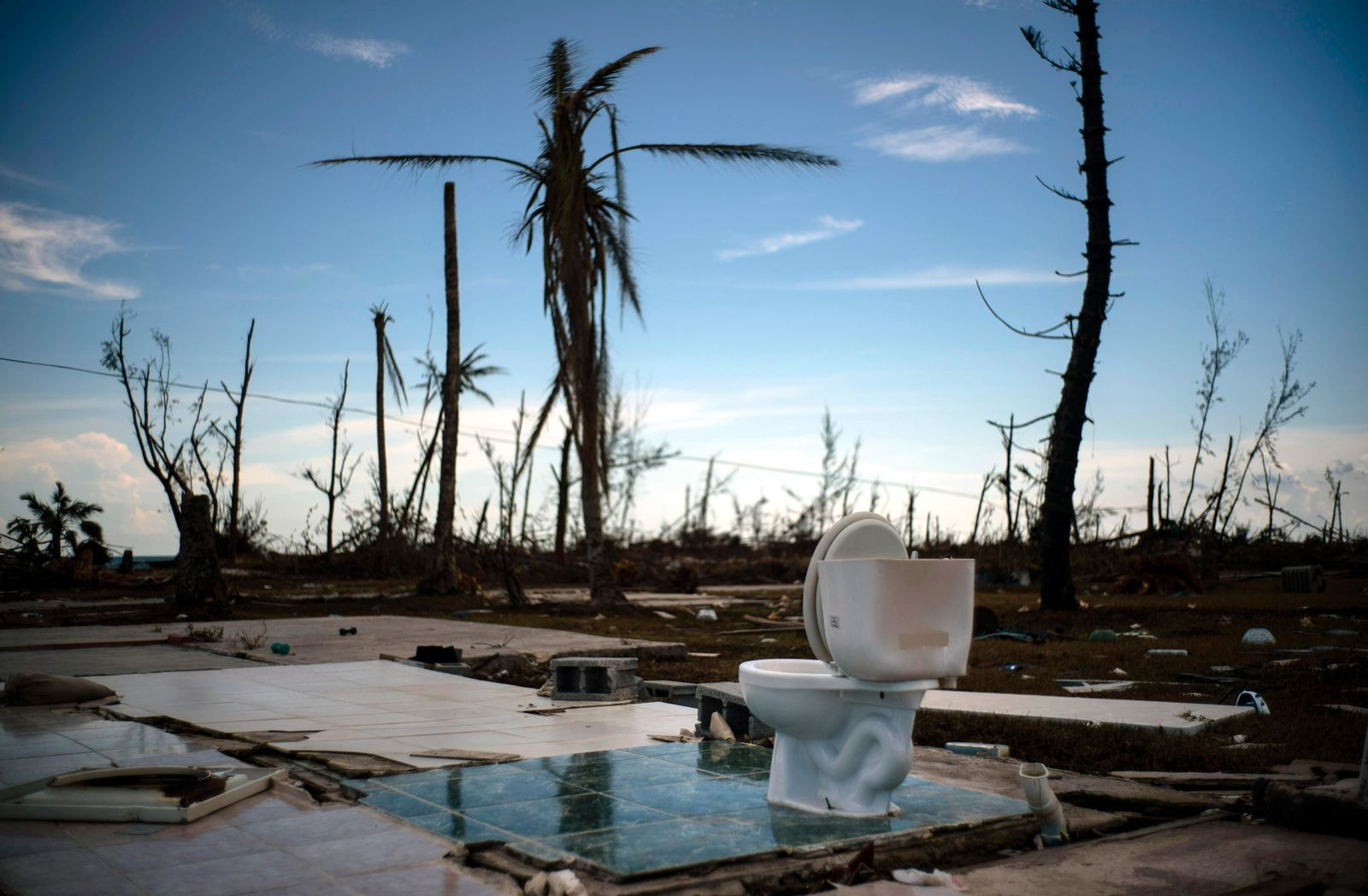 A toilet stands amid the rubble of what was once a home after it was destroyed by Hurricane Dorian one week ago in Pelican Point, Grand Bahama, Bahamas, Sunday, Sept. 8, 2019. (AP Photo/Ramon Espinosa)