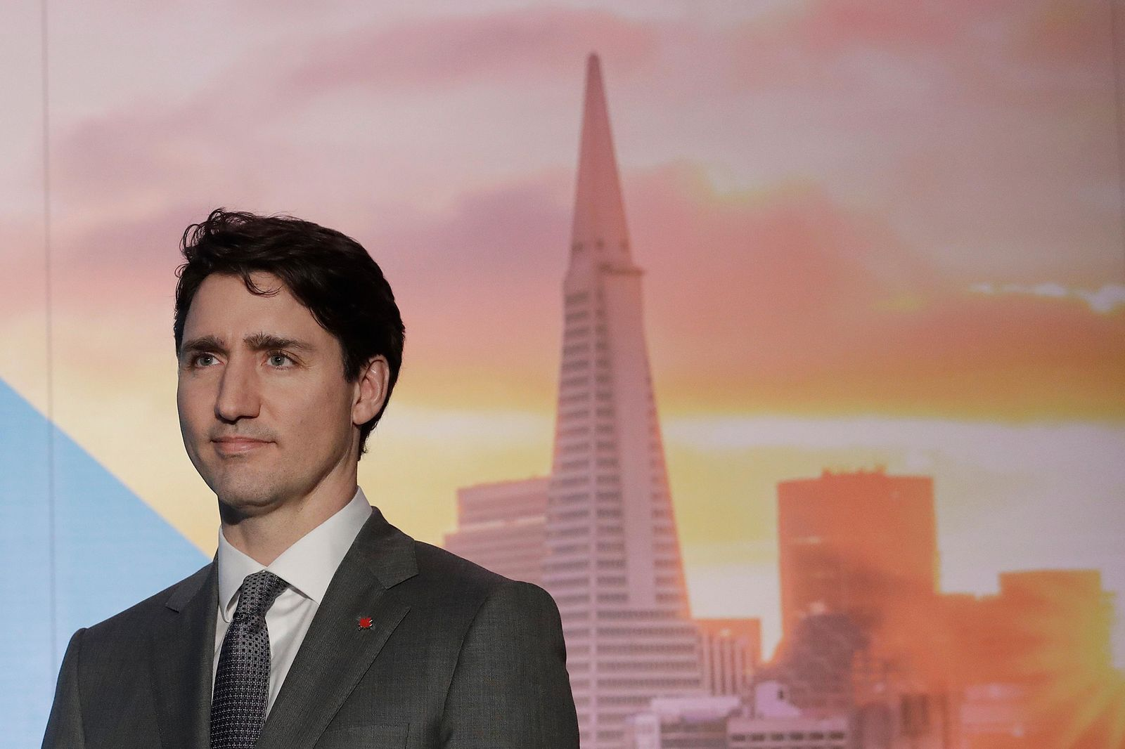 FILE - In this Feb. 8, 2018, photo, with an image of the San Fransisco skyline in the background, Canada's Prime Minister Justin Trudeau waits to speak at the AppDirect office in San Francisco.{ } (AP Photo/Jeff Chiu, File)