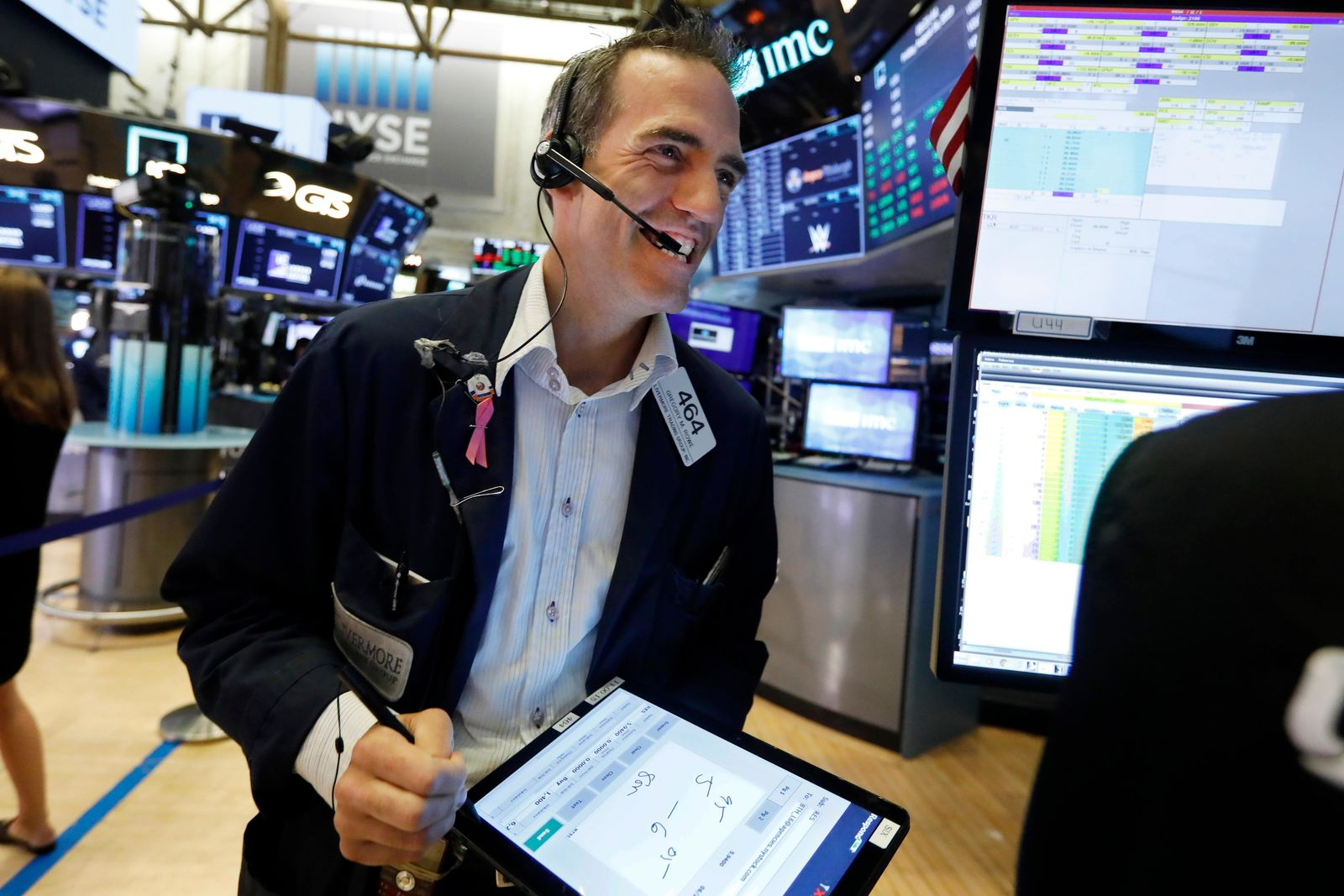 Trader Gregory Rowe works on the floor of the New York Stock Exchange, Friday, Aug. 16, 2019. Stocks are opening broadly higher at the end of a turbulent week. (AP Photo/Richard Drew)