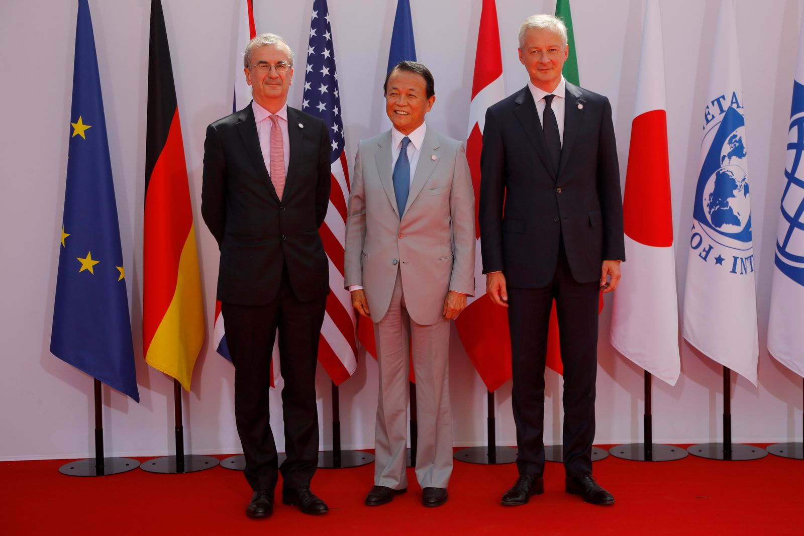 French Finance Minister Bruno Le Maire, right, welcomes Japan's Finance Minister Taro Aso , center, with Governor of the Bank of France Francois Villeroy de Galhau, at the G-7 Finance Wednesday July 17, 2019.{ } (AP Photo/Michel Euler)