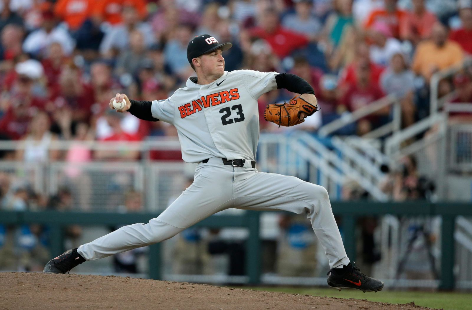 Oregon State pitcher Kevin Abel (23) throws against Arkansas during the eighth inning of Game 3 in the NCAA College World Series baseball finals, Thursday, June 28, 2018, in Omaha, Neb. (AP Photo/Nati Harnik)