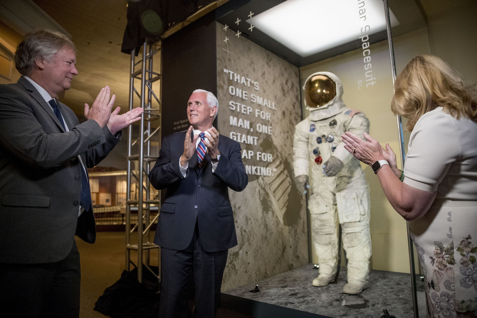 From left, Rick Armstrong, the son of Neil Armstrong, Vice President Mike Pence, and Smithsonian's National Air and Space Museum Director Ellen Stofan, unveil Neil Armstrong's Apollo 11 spacesuit at the Smithsonian's National Air and Space Museum on the National Mall in Washington, Tuesday, July 16, 2019. (AP Photo/Andrew Harnik, Pool)