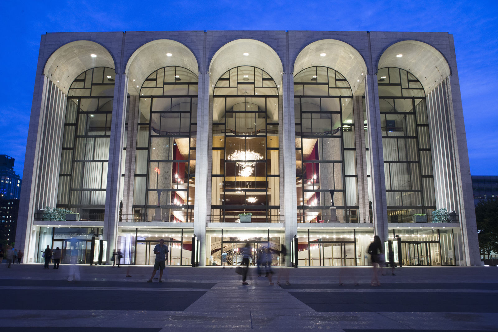 FILE - In this Aug. 1, 2014, file photo, pedestrians make their way in front of the Metropolitan Opera house at New York's Lincoln Center. (AP Photo/John Minchillo, File)