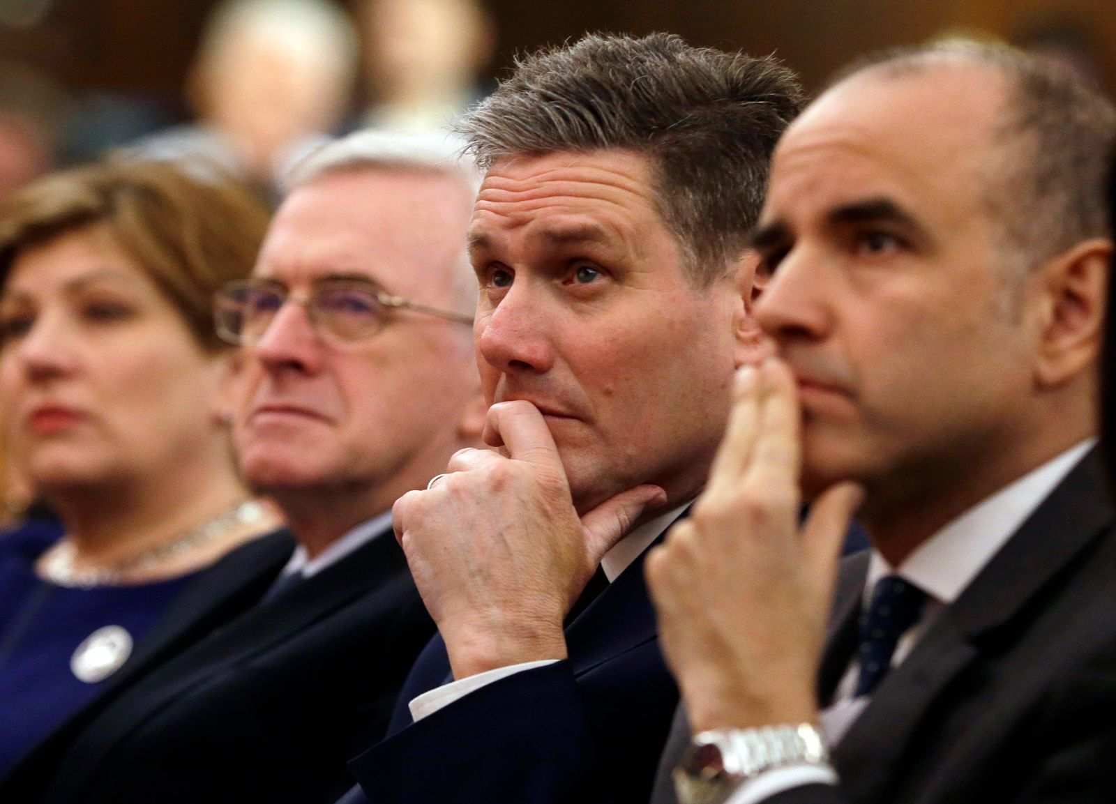FILE - In this London, Friday, Feb. 24, 2017 file photo, Keir Starmer, second right, of the Labour party listens to Leader of the opposition Labour Party Jeremy Corbyn's speech laying out the plan for the party following the Brexit vote in June 2016. (AP Photo/Alastair Grant, File)