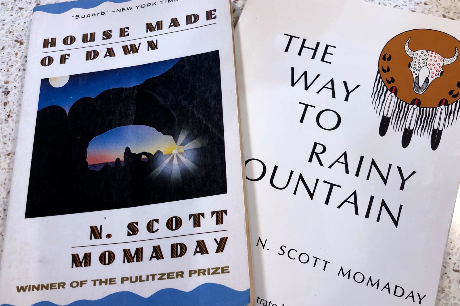 "In this Wednesday, Nov. 13, 2019, photo, a copy of ""House Made of Dawn"" and ""The Way to Rainy Mountain"" by Kiowa author N. Scott Momaday sits in his Santa Fe, N.M., home between writing sessions. In a rare interview with The Associated Press, Momaday, who won a Pulitzer Prize in 1969 for ""House Made of Dawn,"" says he's excited about a new PBS American Masters documentary about his life. But he remains surprised and humbled that other writers have said his work has influenced them. (AP Photo/Russell Contreras)"