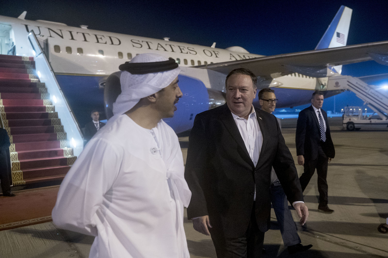 Secretary of State Mike Pompeo, center, is greeted by United Arab Emirates Foreign Minister Sheikh Abdullah bin Zayed Al Nahyan, left, as he arrives at Abu Dhabi International Airport in Abu Dhabi?, United Arab Emirates, Monday, July 9, 2018.  (AP Photo/Andrew Harnik, Pool)