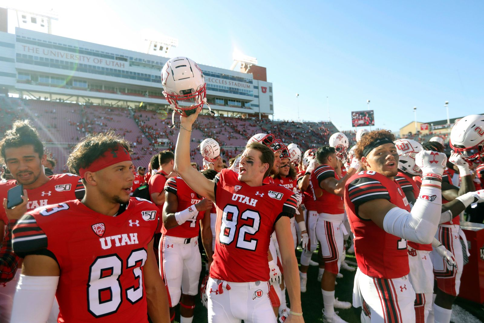 Utah wide receiver Dylan Slavens (82) celebrates with his teammate following their victory over Idaho State during an NCAA college football game Saturday, Sept. 14, 2019, in Salt Lake City. (AP Photo/Rick Bowmer)
