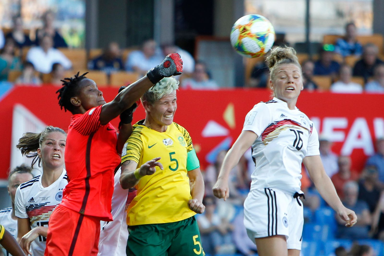 South Africa goalkeeper Andile Dlamini, left, clears the ball against Germany's Linda Dallmann, right during the Women's World Cup Group B soccer match between South Africa and Germany at the Stade de la Mosson in Montpellier, France, Monday, June 17, 2019. (AP Photo/Claude Paris)