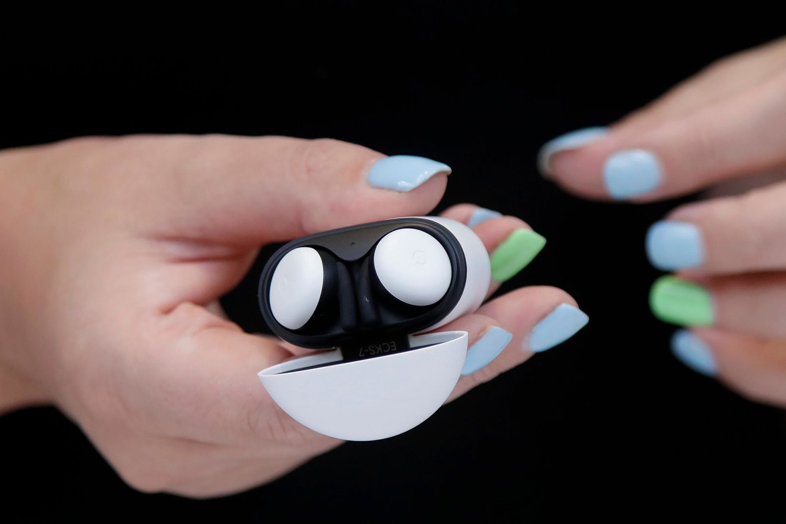 In this Tuesday, Sept. 24, 2019, photo Isabelle Olsson, head of color & design for Nest, shows the Pixel buds in a case at Google in Mountain View, Calif. (AP Photo/Jeff Chiu)
