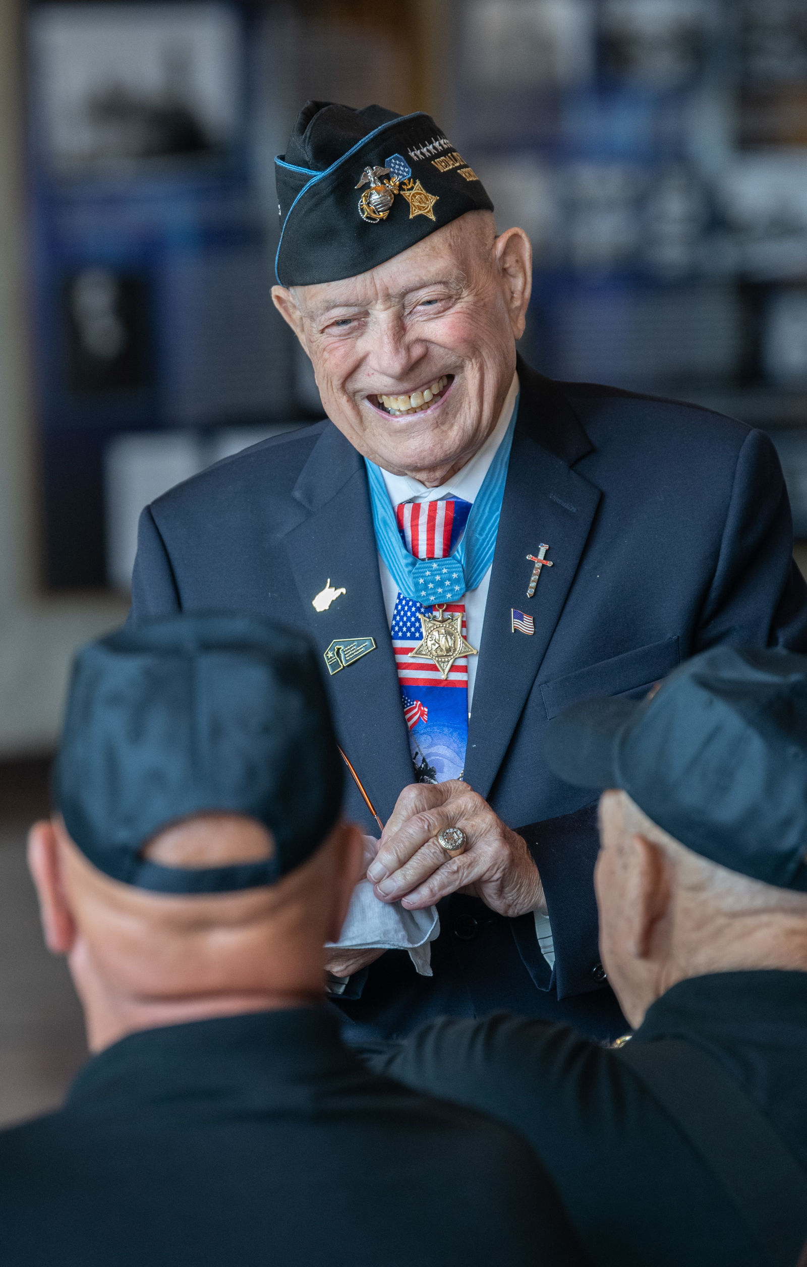 "Medal of Honor Recipient Hershel ""Woody"" Williams interacts with attendees before the Gold Star Families Memorial Monument groundbreaking ceremony, July 27, 2019, at the West Virginia Division of Arts, Culture and History Cultural Center, Charleston, W.Va. The Gold Star Families Memorial Monuments are a nationwide project of the Hershel ""Woody"" Williams Medal of Honor Foundation, honoring the families who have lost loved ones in service to the nation. Currently, there are 51 existing monuments in 42 states, with another 62 in progress. (U.S. Army National Guard photo by Bo Wriston)"