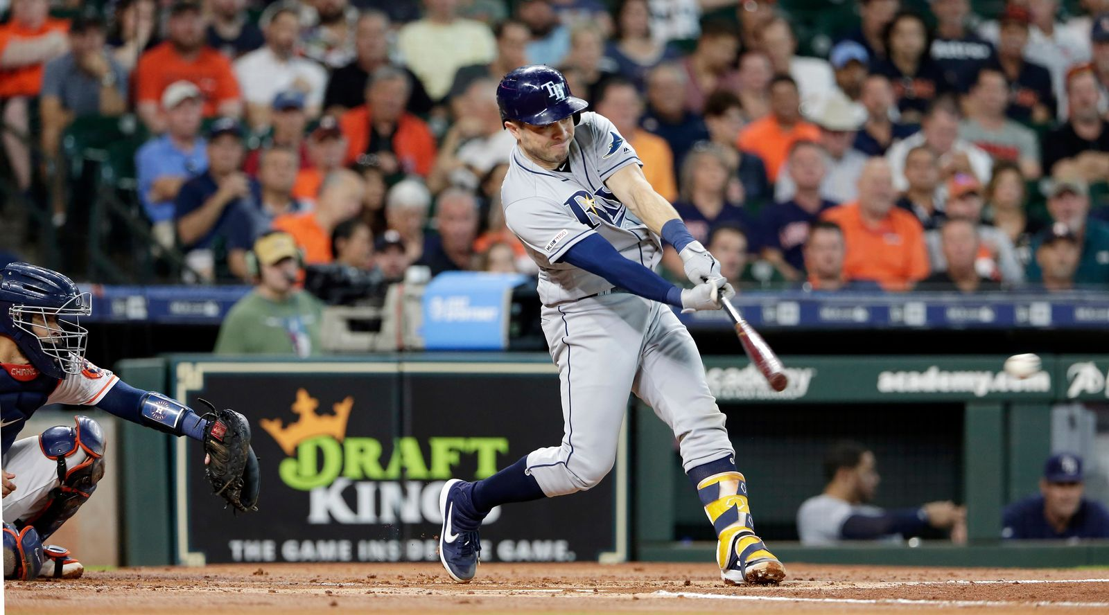 Tampa Bay Rays' Travis d'Arnaud connects for a single RBI hit in front of Houston Astros catcher Robinson Chirinos during the second inning of a baseball game Thursday, Aug. 29, 2019, in Houston. (AP Photo/Michael Wyke)