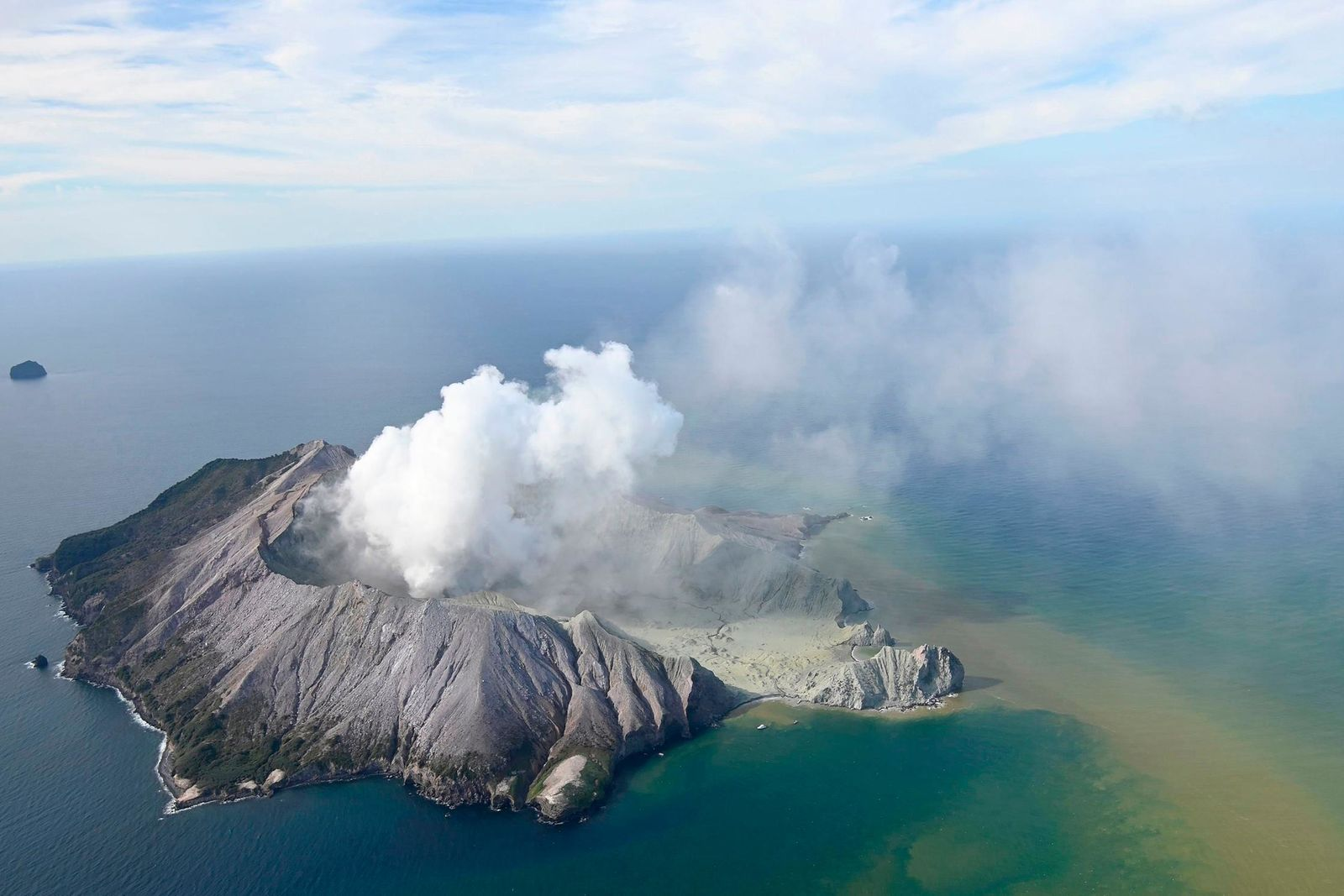 This aerial photo shows White Island after its volcanic eruption in New Zealand Monday, Dec. 9, 2019.{ } (George Novak/New Zealand Herald via AP)