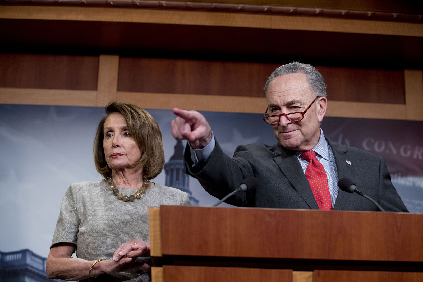 Senate Minority Leader Sen. Chuck Schumer of N.Y., accompanied by Speaker Nancy Pelosi of Calif., left, calls on a reporter during a news conference on Capitol Hill in Washington, Friday, Jan. 25. (AP Photo/Andrew Harnik)