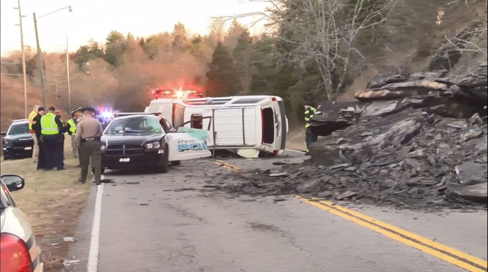 WATCH: SUV goes airborne after hitting rockslide, lands on police cruiser (Bristol PD/WCYB)