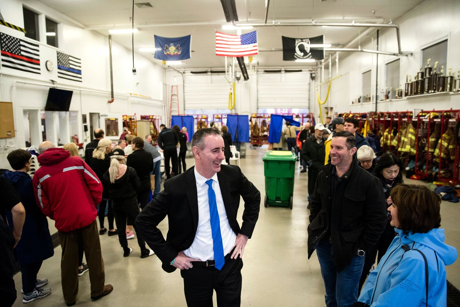 Candidate for Pennsylvania's 1st Congressional District Rep. Brian Fitzpatrick, R-Pa., waits in line to vote in Langhorne, Pa., Tuesday, Nov. 6, 2018. (AP Photo/Matt Rourke)