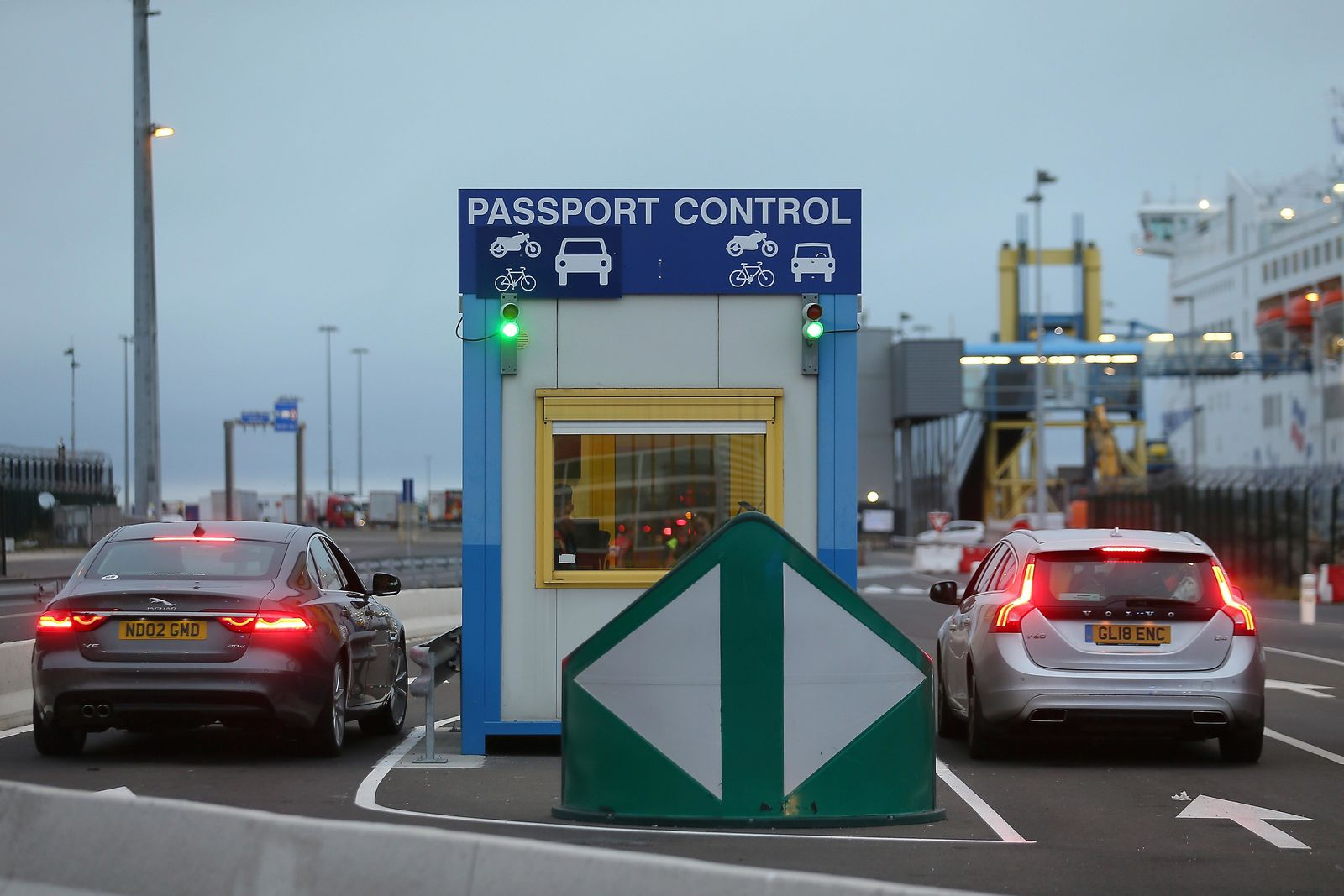 Cars bearing British license plates stop at a passport control booth at the transit zone at the port of Ouistreham, Normandy, Thursday, Sept.12, 2019. France has trained 600 new customs officers and built extra parking lots arounds its ports to hold vehicles that will have to go through extra checks if there is no agreement ahead of Britain's exit from the EU, currently scheduled on Oct. 31. (AP Photo/David Vincent)