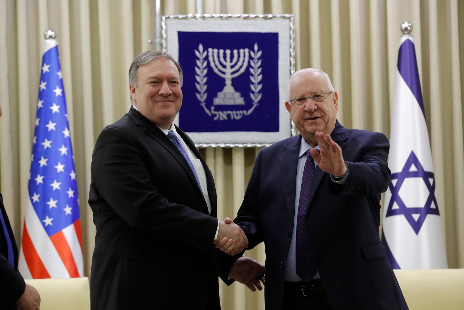 U.S. Secretary of State Mike Pompeo, left, and Israeli President Reuven Rivlin shake hands during their meeting in Jerusalem Thursday, March 21, 2019. (Jim Young/Pool Photo via AP)