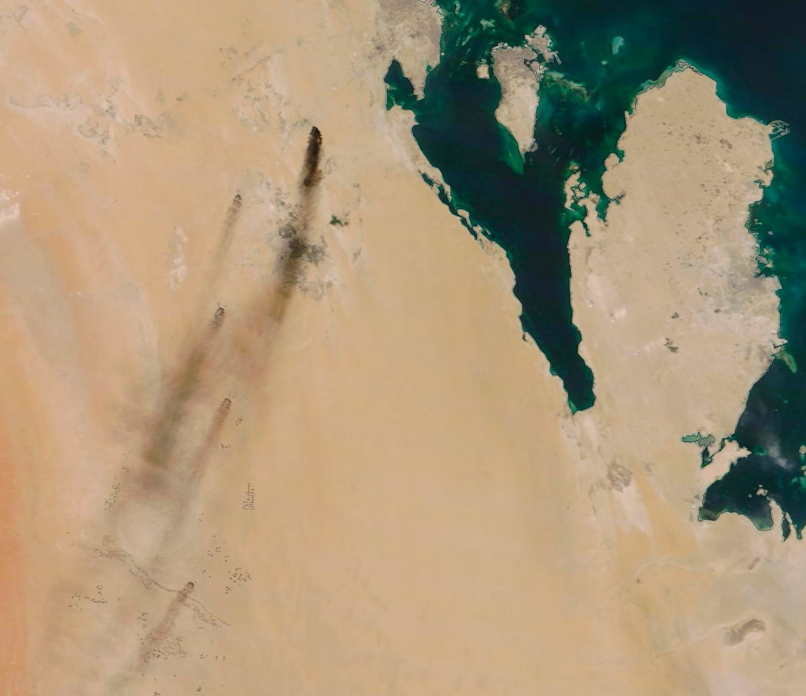 This Saturday, Sept. 14, 2019, satellite image provided by NASA Worldview shows fires following Yemen's Houthi rebels claiming a drone attack on two major oil installations in eastern Saudi Arabia. The drones attacked the world's largest oil processing facility in Saudi Arabia and a major oilfield operated by Saudi Aramco early Saturday, sparking a huge fire at a processor crucial to global energy supplies. The island shown in the image is Bahrain, while the peninsula in the image is Qatar. (NASA Worldview via AP)