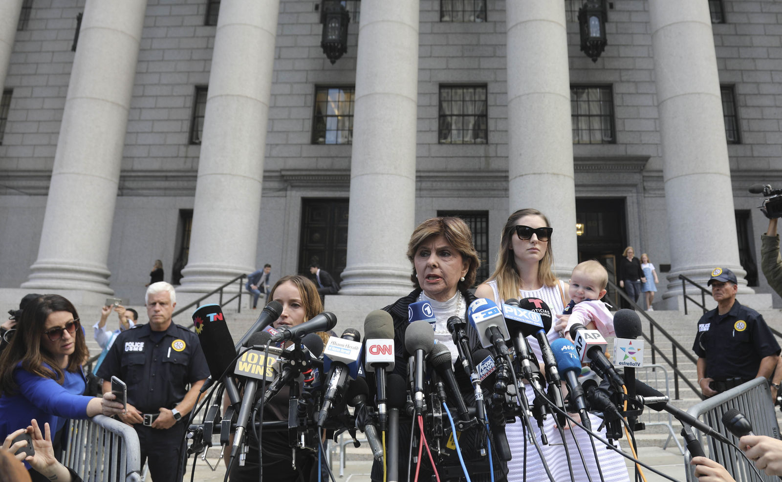 Attorney Gloria Allred, center, flanked by two of her clients, speak during a news conference after leaving a Manhattan court where sexual victims, on invitation of a judge, addressed a hearing after the accused Jeffrey Epstein killed himself before facing sex trafficking charges, Tuesday Aug. 27, 2019, in New York. (AP Photo/Bebeto Matthews)