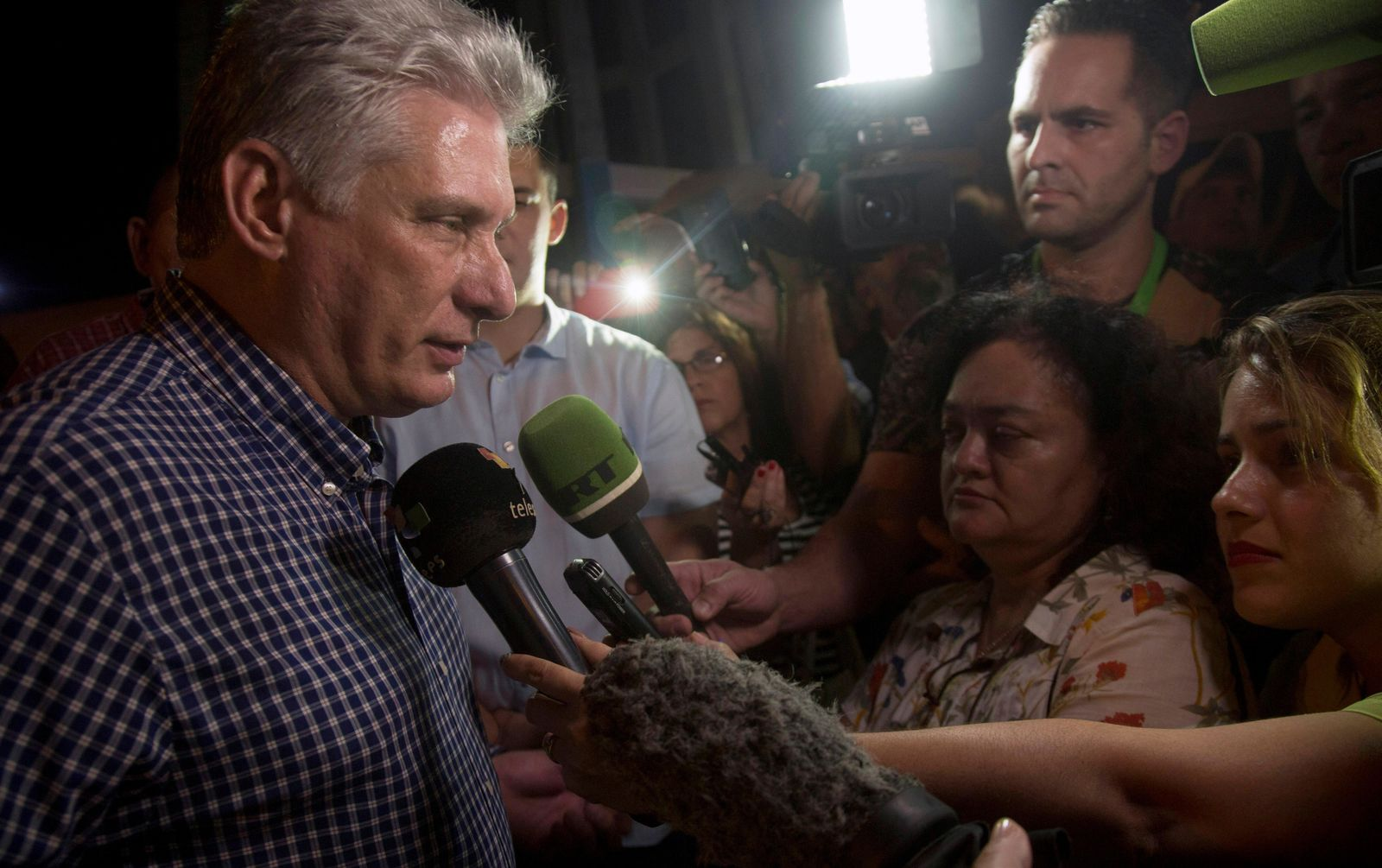 Cuba's President Miguel Diaz-Canel, left, talks to the media after a tour in Las Tunas, Cuba, Thursday, Jan. 16, 2020. (AP Photo/Ismael Francisco)