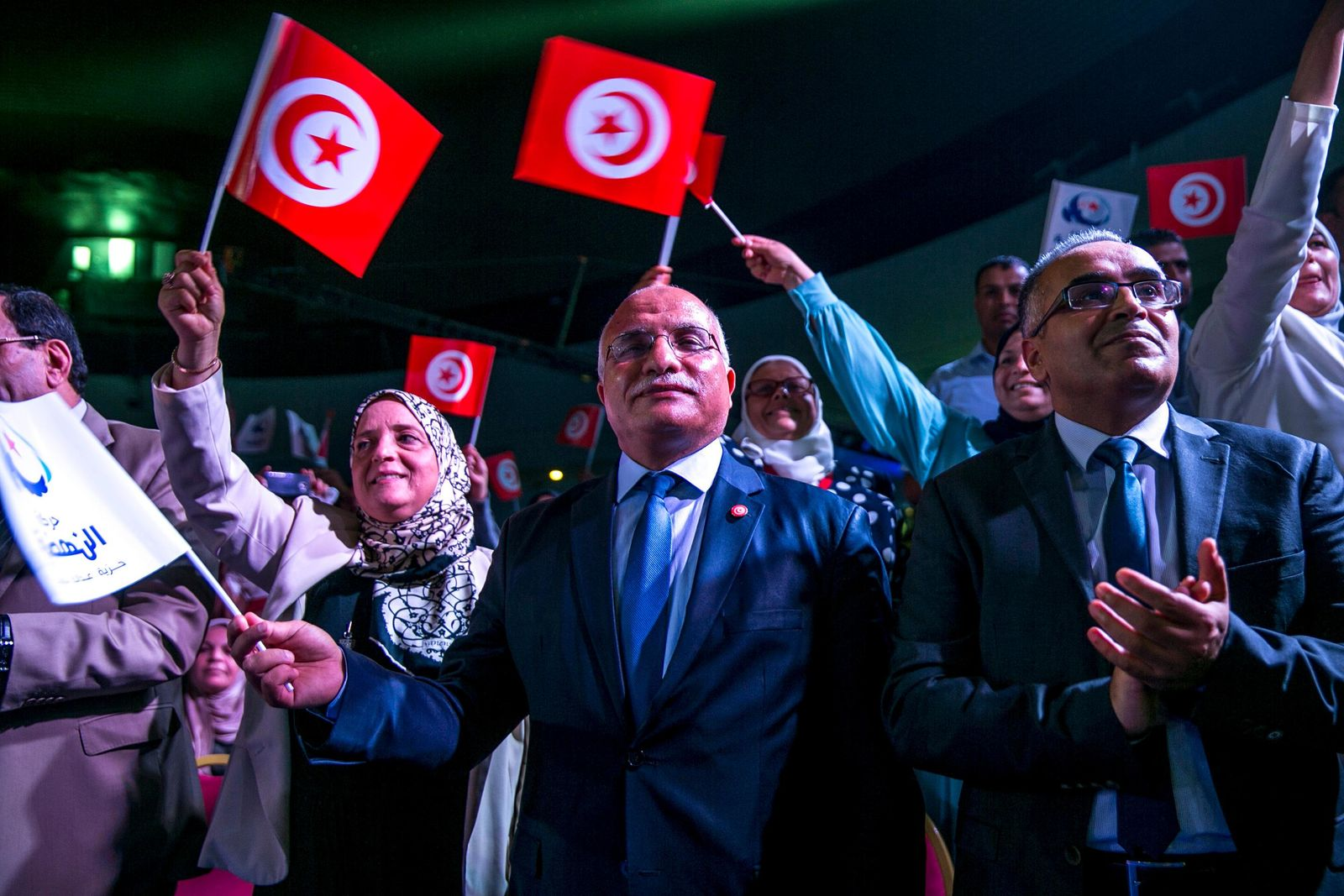Supporters of Islamist party Ennahda attend the meeting with Vice President of the Islamist party Ennahda and candidate for the upcoming presidential elections Abdelfattah Mourou in Tunis, Tunisia, Friday, Aug. 30, 2019. (AP Photo/Hassene Dridi)