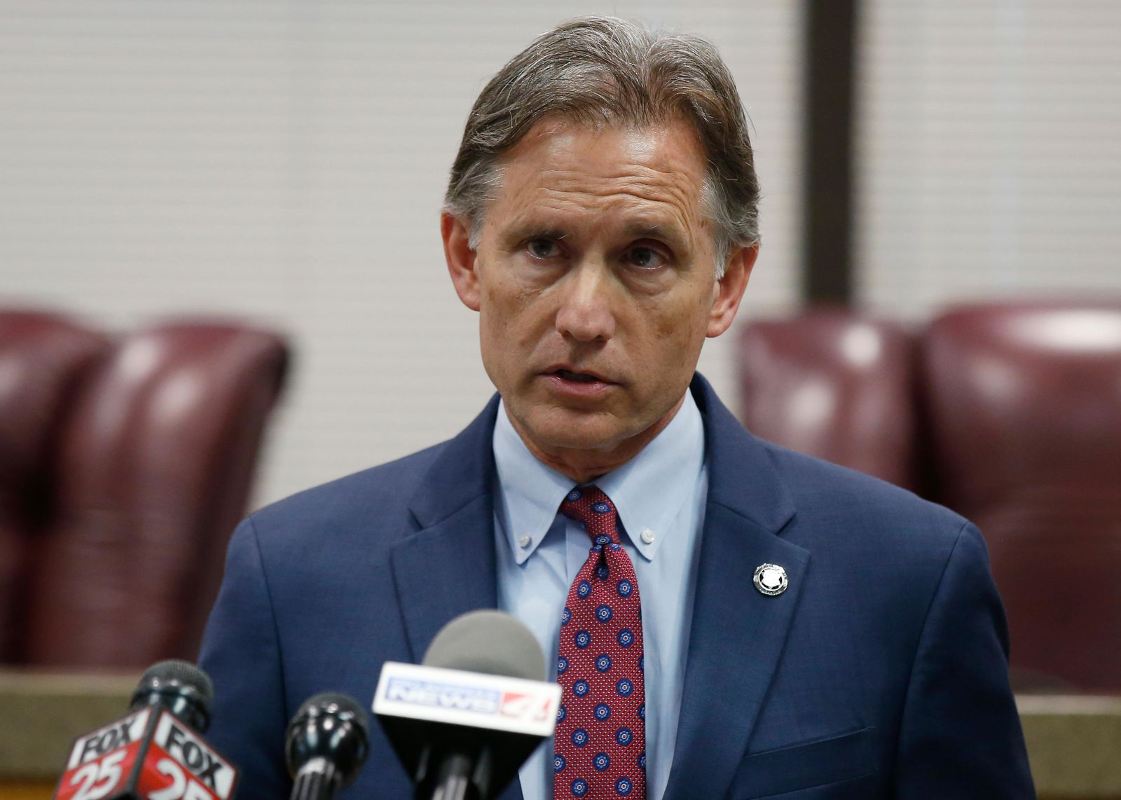 Oklahoma Attorney General Mike Hunter speaks to the media at a news conference following closing arguments in Oklahoma's ongoing opioid drug lawsuit against Johnson & Johnson Monday, July 15, 2019, in Norman, Okla. (AP Photo/Sue Ogrocki)