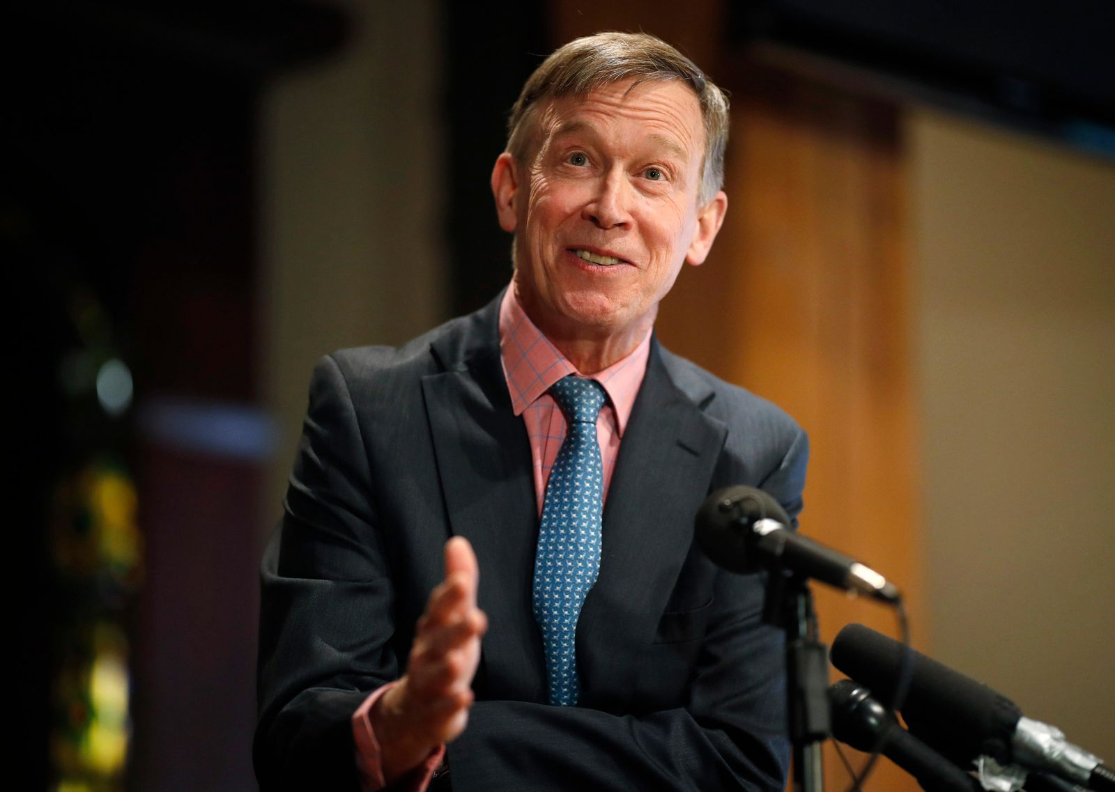 Former Colorado Gov. John Hickenlooper responds to questions during a news conference in the brewpub that he established before his foray into politics Wednesday, March 6, 2019, in lower downtown Denver. (AP Photo/David Zalubowski)