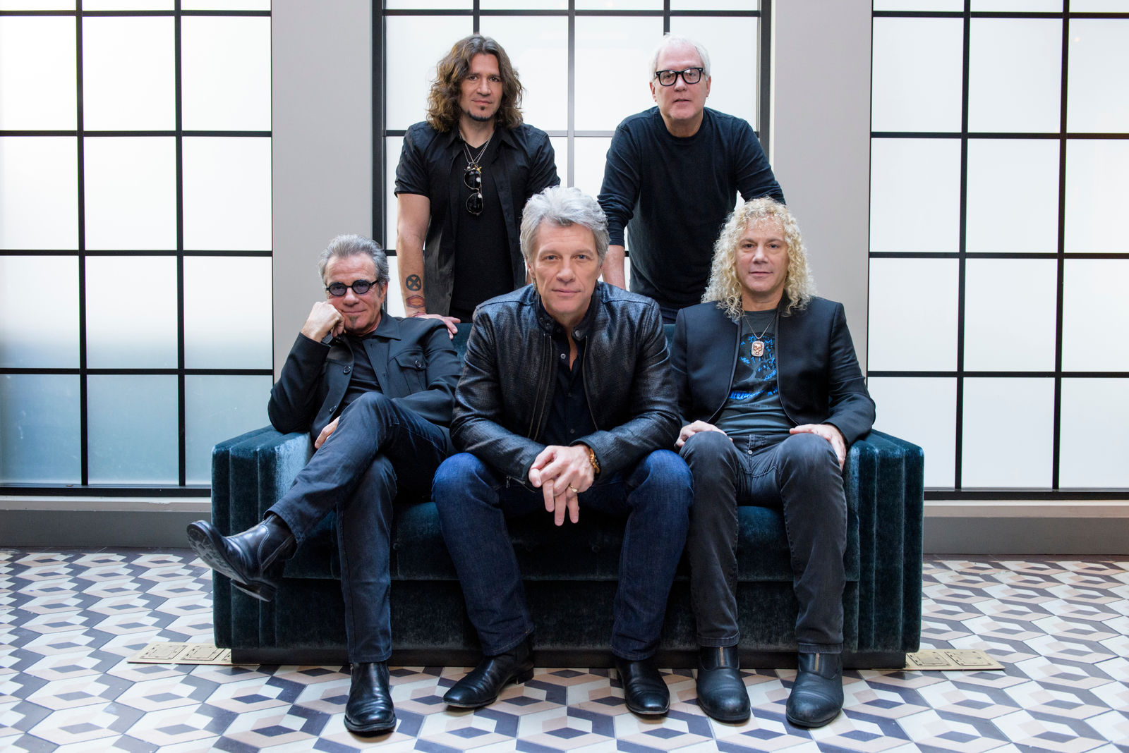 "FILE - In this Oct. 19, 2016 file photo, members of Bon Jovi front row from left, Tico Torres, Jon Bon Jovi, David Bryan, back row from left, Phil X, and Hugh McDonald pose for a portrait in promotion of their new album ""This House is Not for Sale"" in New York. (Photo by Drew Gurian/Invision/AP, File)"
