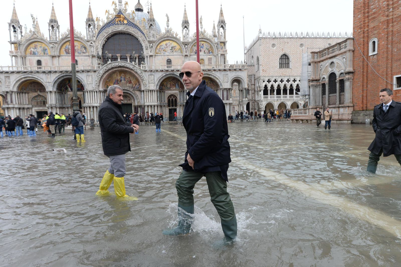 Italy's team manager Gianluca Vialli is seen in St. Mark's Square during a solidarity visit to Venice following the exceptional high water that brought the city to its knees, in Venice, northern Italy, Saturday, Nov. 16, 2019. Four days ago, the Italian lagoon city experienced its worst flooding in more than 50 years. (Andrea Merola/ANSA via AP)