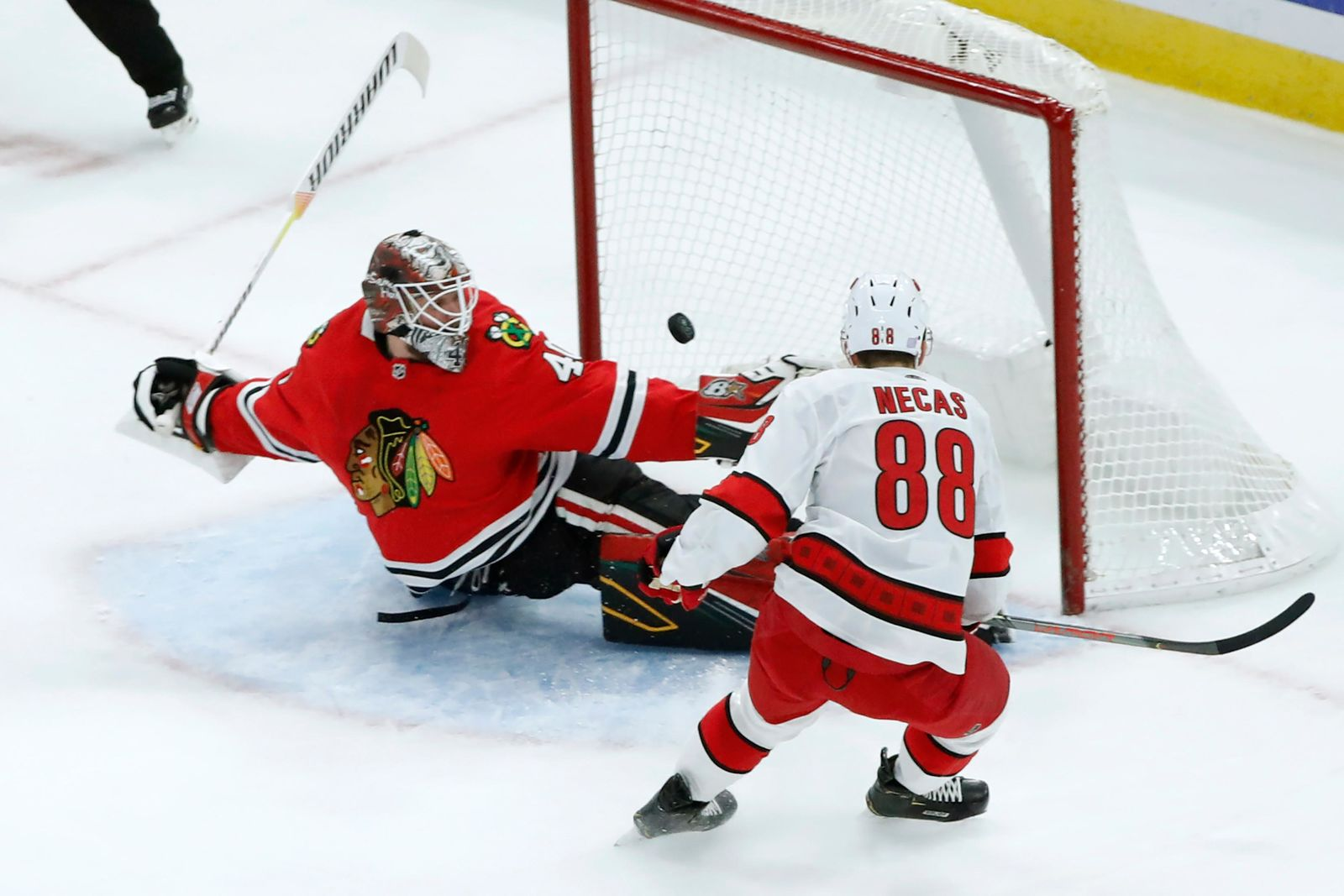 Carolina Hurricanes center Martin Necas (88) scores past Chicago Blackhawks goaltender Robin Lehner during the first period of an NHL hockey game Tuesday, Nov. 19, 2019, in Chicago. (AP Photo/Charles Rex Arbogast)
