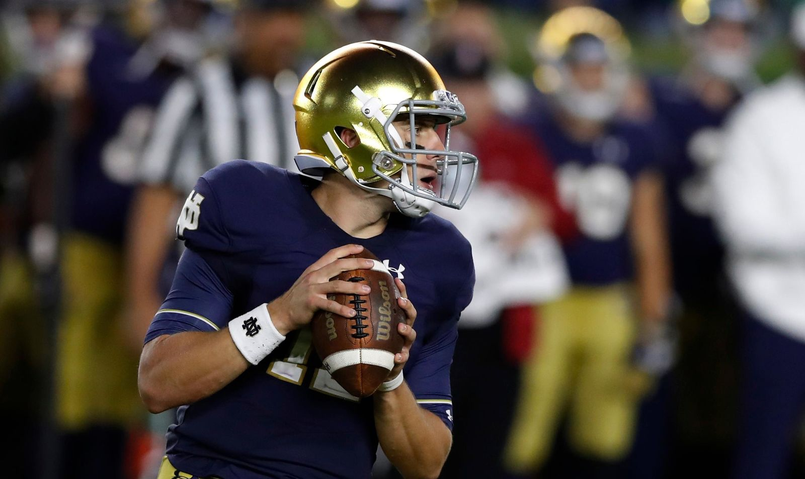 Notre Dame quarterback Ian Book looks downfield during the first half of the team's NCAA college football game against Stanford, Saturday, Sept. 29, 2018, in South Bend, Ind. (AP Photo/Carlos Osorio)