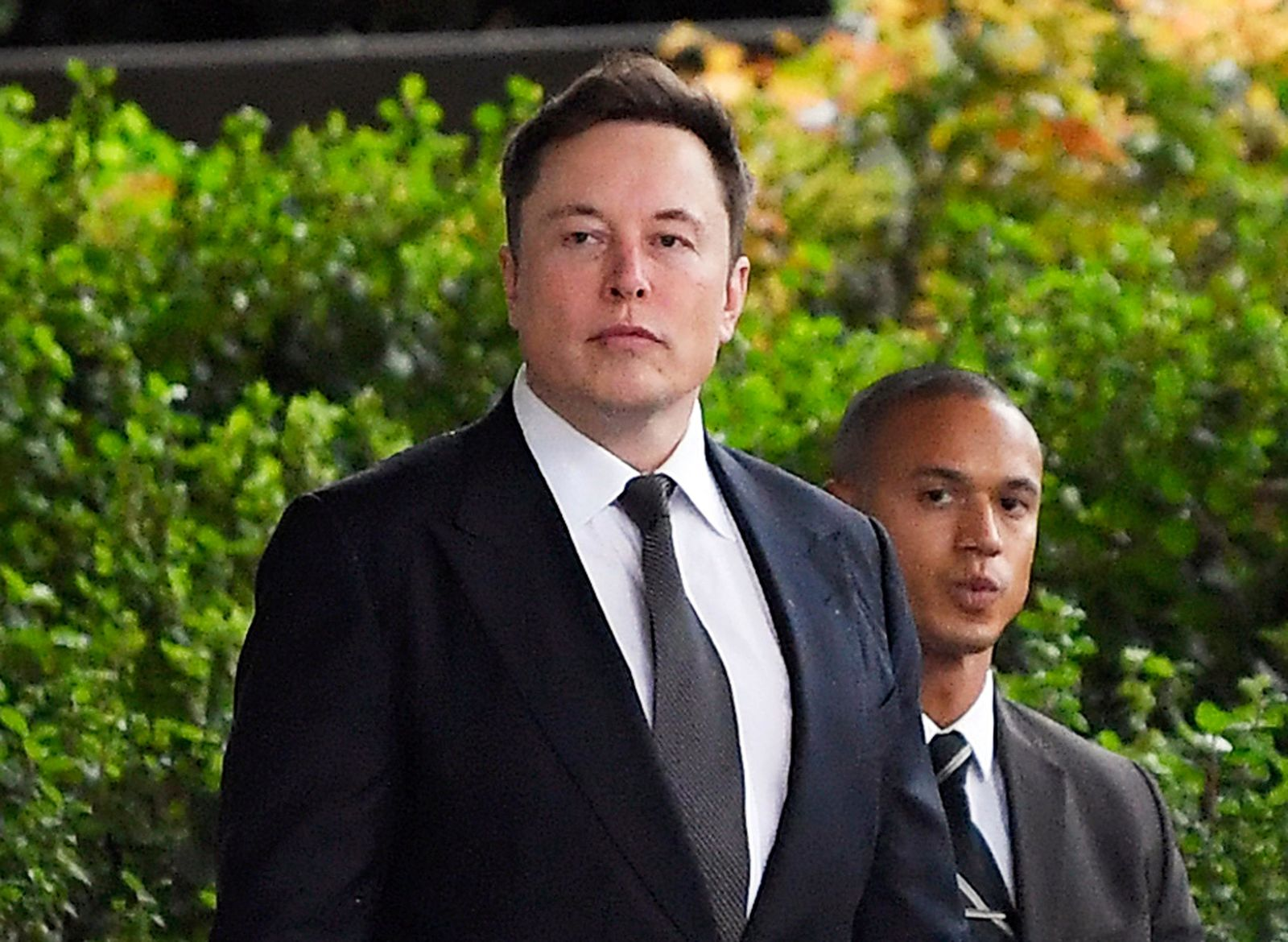 "FILE - In this Wednesday, Dec. 4, 2019 file photo, Tesla CEO Elon Musk arrives at U.S. District Court in Los Angeles. Musk did not defame a British cave explorer when he called him ""pedo guy"" in an angry tweet, a Los Angeles jury found Friday, Dec. 6, 2019. (AP Photo/Mark J. Terrill, File)"