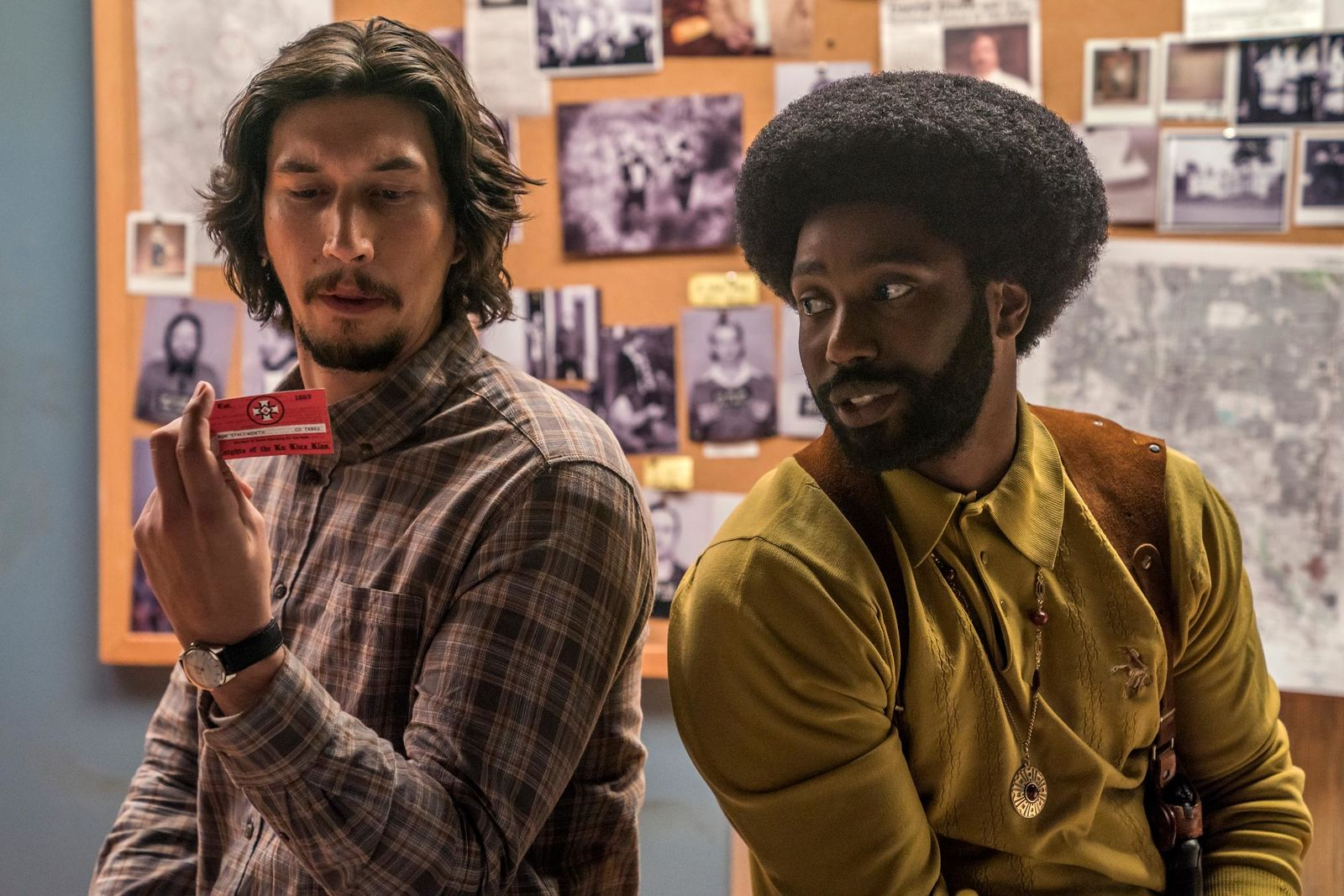 "This image released by Focus Features shows Adam Driver, left, and John David Washington in a scene from ""BlacKkKlansman."" The film is nominated for an Oscar for best picture. The 91st Academy Awards will be held on Sunday. (David Lee/Focus Features via AP)"