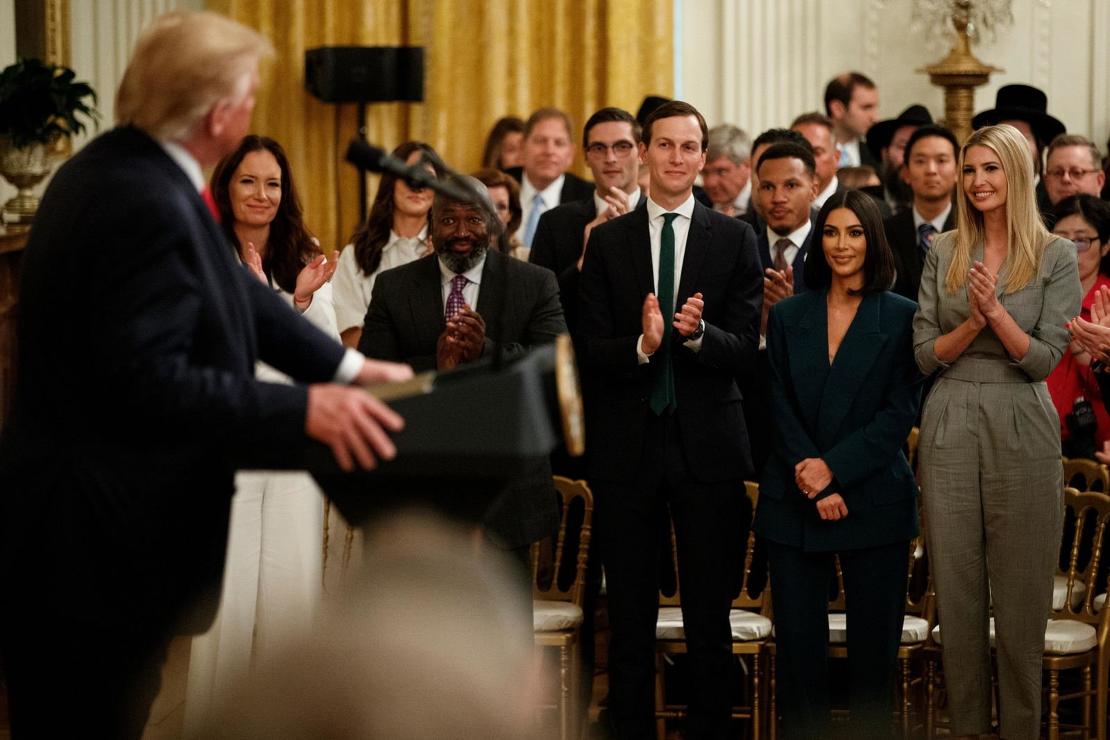 Kim Kardashian West, who is among the celebrities who have advocated for criminal justice reform, stands with White House senior adviser Jared Kushner and Ivanka Trump during an event on second chance hiring and criminal justice reform with President Donald Trump in the East Room of the White House, Thursday, June 13, 2019, in Washington. (AP Photo/Evan Vucci)