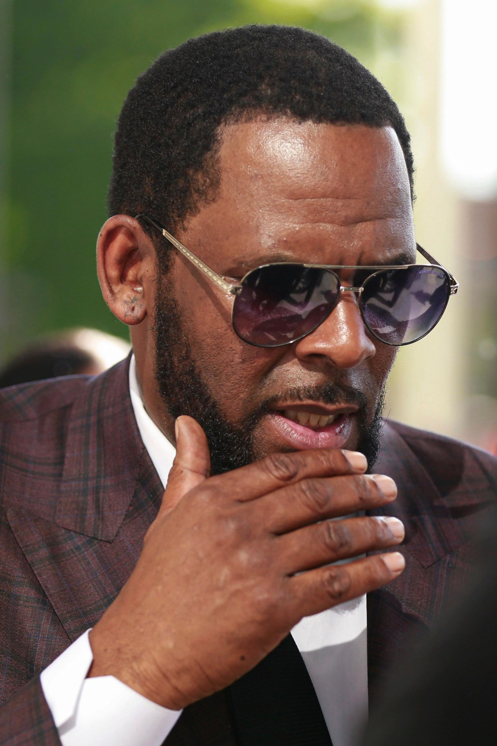 R&B singer R. Kelly arrives at the Leighton Criminal Court building for an arraignment on sex-related felonies Wednesday, June 26, 2019 in Chicago. (AP Photo/Amr Alfiky)