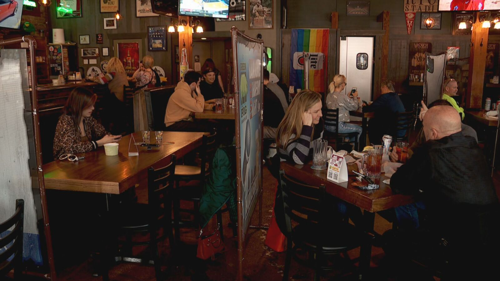 Six counties, including Davis and Salt Lake, were moved to the moderate transmission level Thursday. The change means the 6 feet of distance required at restaurants, venues, bars and gyms is, for the most part, now just a recommendation, not a requirement. (KUTV)