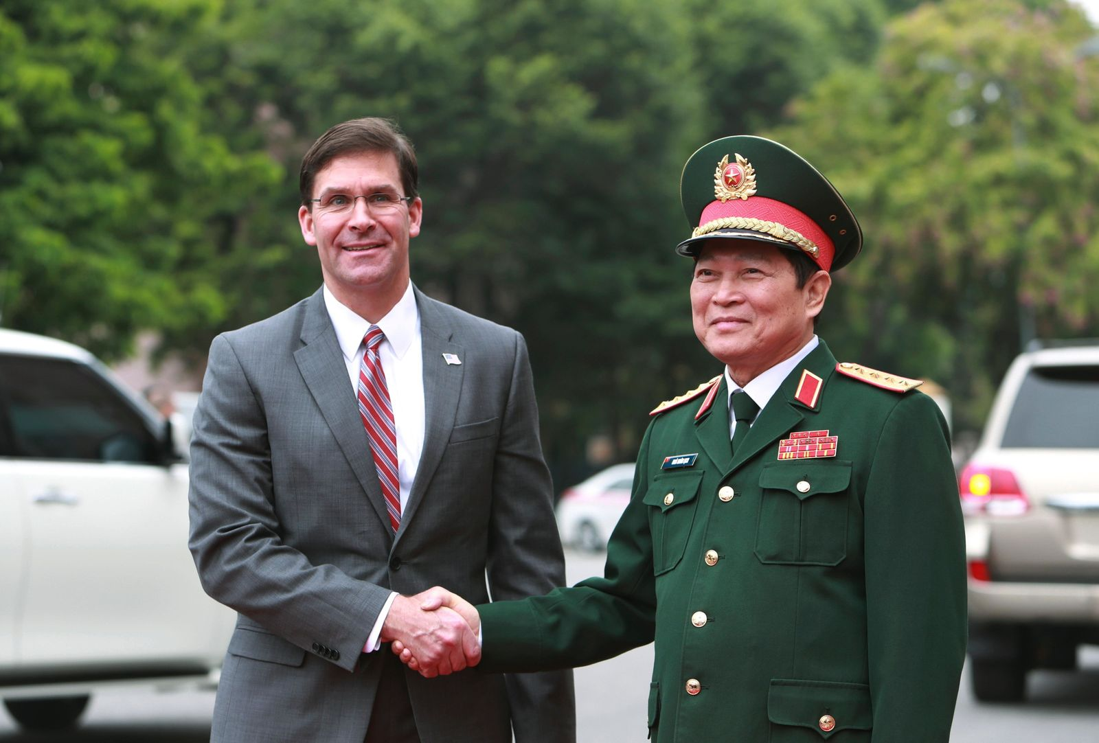 U.S. Defense Secretary Mark Esper, left, and Vietnamese Defense Minister Ngo Xuan Lich shake hands in Hanoi, Vietnam Wednesday, Nov. 20, 2019. (AP Photo/Hau Dinh)