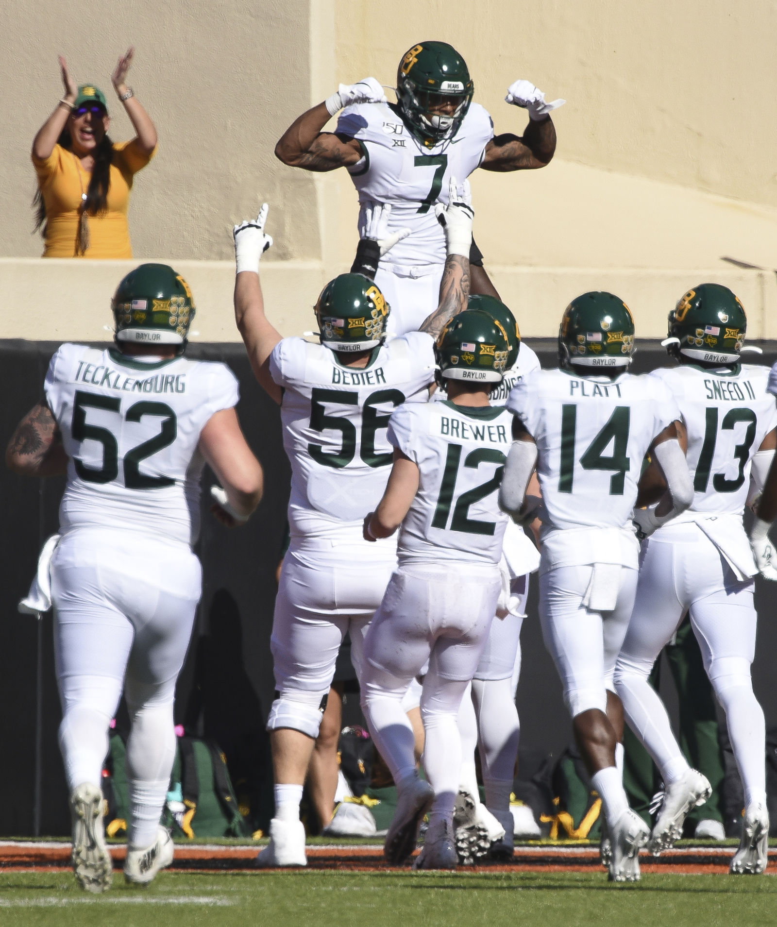 Baylor running back John Lovett (7) is lifted by teammates as he celebrates the first touchdown in the first half of an NCAA college football game against Oklahoma State in Stillwater, Okla., Saturday, Oct. 19, 2019. (AP Photo/Brody Schmidt)