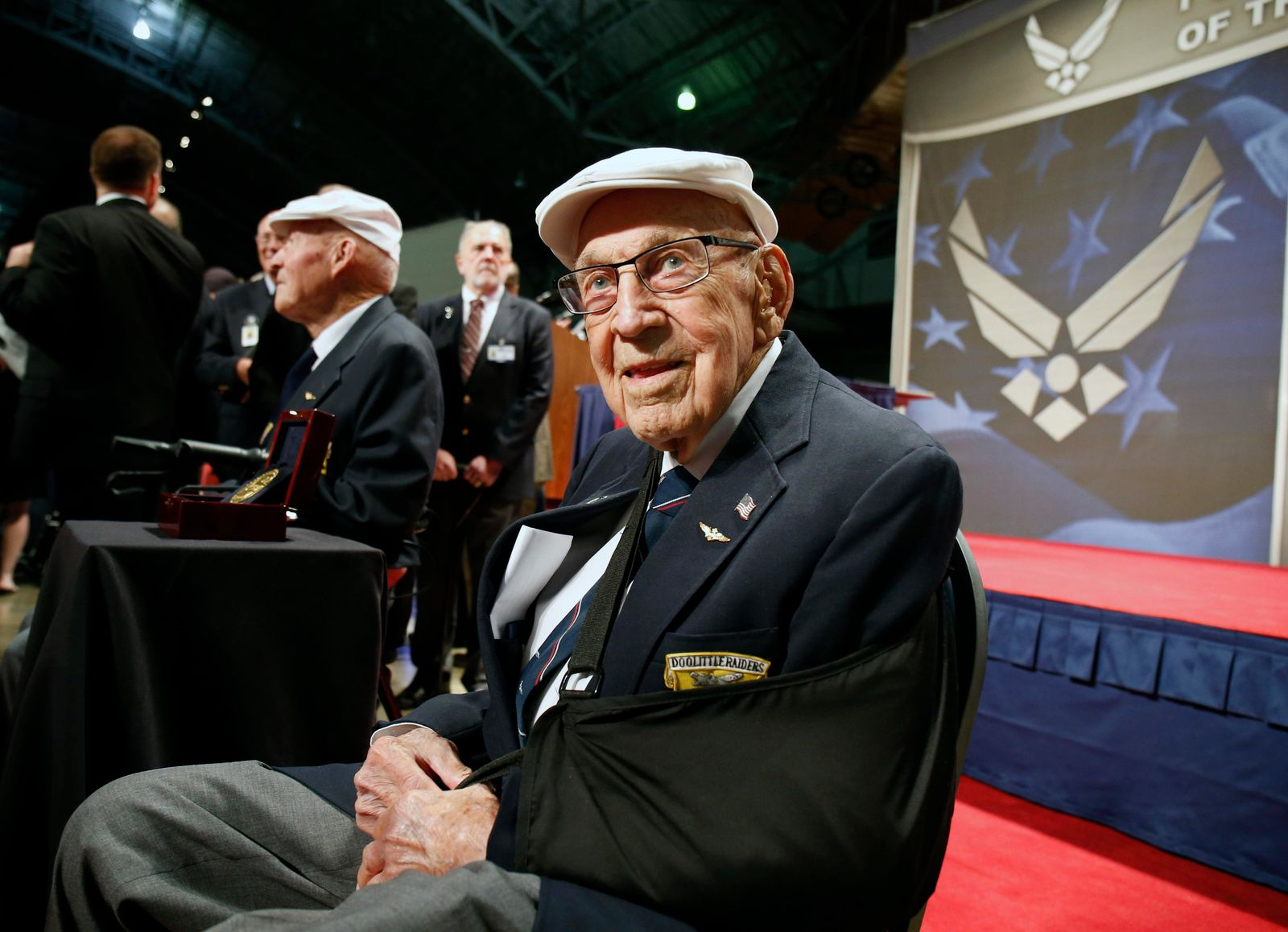 "FILE - In this April 18, 2015, file photo, two members of the Doolittle Tokyo Raiders, retired U.S. Air Force Lt. Col. Richard ""Dick"" Cole, seated front, and retired Staff Sgt. David Thatcher, seated left, pose for photos after the presentation of a Congressional Gold Medal honoring the Doolittle Tokyo Raiders at the National Museum of the U.S. Air Force at Wright-Patterson Air Force Base in Dayton, Ohio. Retired Lt. Col. Richard ""Dick"" Cole, the last of the 80 Doolittle Tokyo Raiders who carried out the daring U.S. attack on Japan during World War II, has died at a military hospital in Texas. He was 103. A spokesman says Cole died Tuesday, April 9, 2019, at Brooke Army Medical Center in San Antonio, Texas. (AP Photo/Gary Landers, File)"