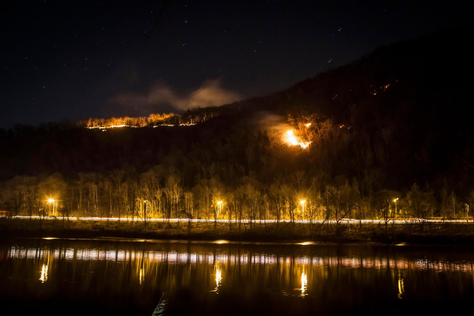 A fire burns on Mount Tammany in the Delaware Water Gap National Recreation Area in Hardwick Township, N.J., Sunday, Feb. 23, 2020. (Daniel Freel/The New Jersey Herald via AP)