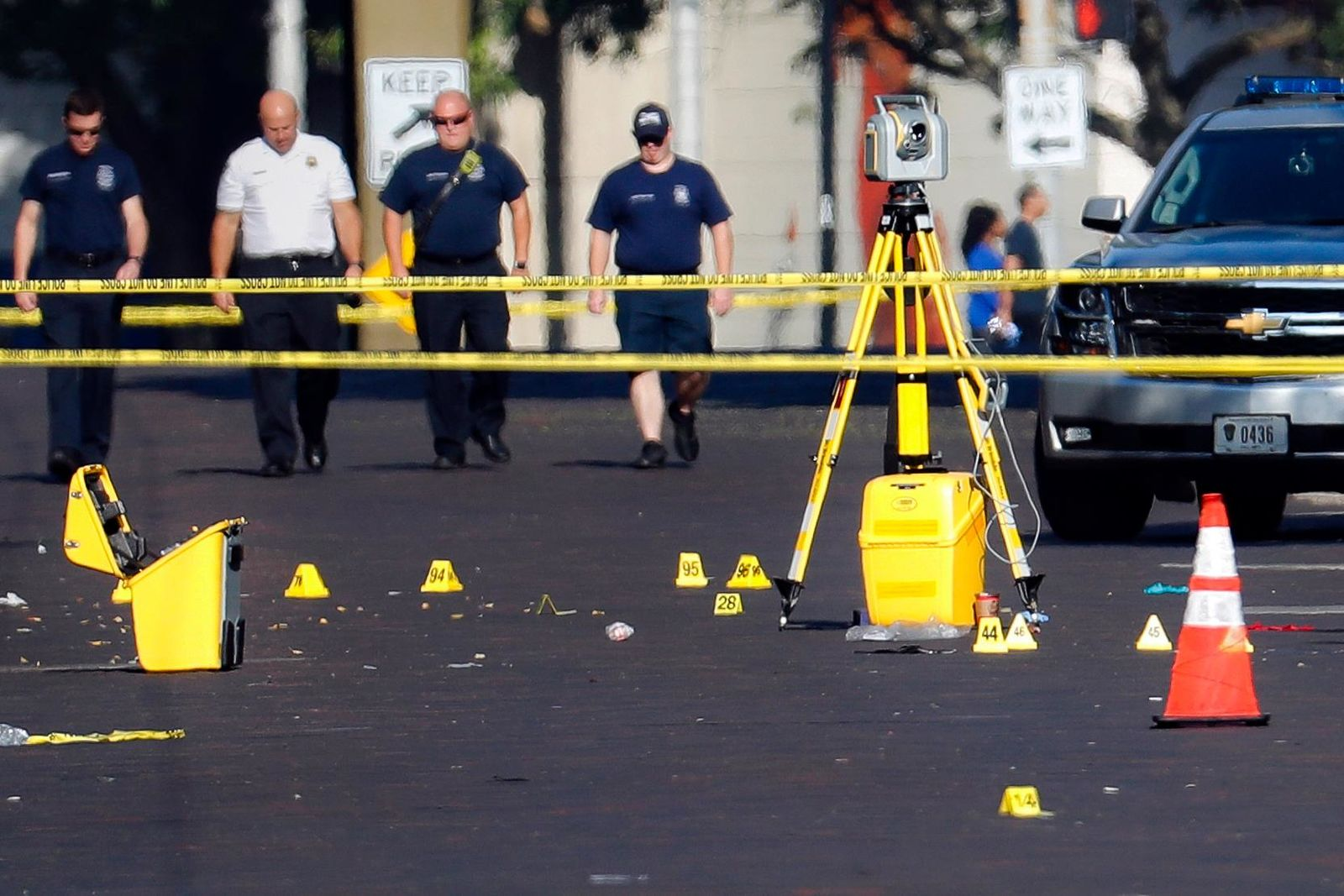 Evidence markers rest on the street at the scene of a mass shooting Sunday, Aug. 4, 2019, in Dayton, Ohio. Several people in Ohio have been killed in the second mass shooting in the U.S. in less than 24 hours, and the suspected shooter is also deceased, police said. (AP Photo/John Minchillo)