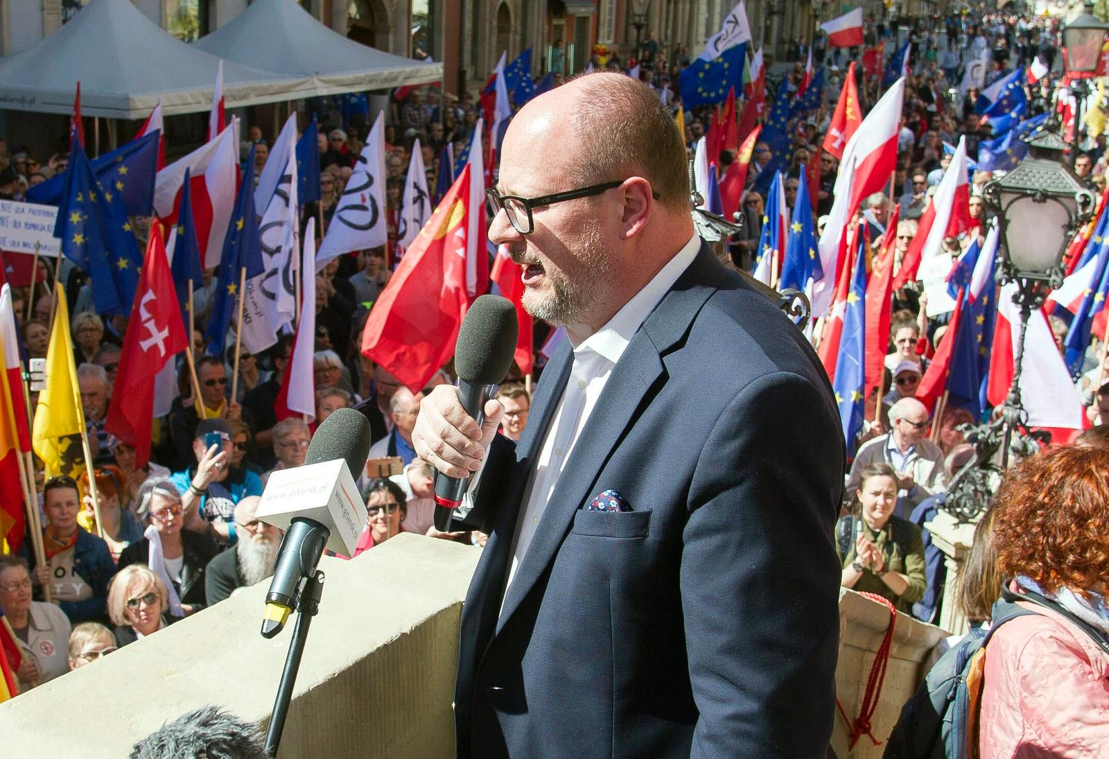 In this Saturday, April 21, 2018 file photo, the mayor of Gdansk, Pawel Adamowicz addresses a rally organized in protest against a recent gathering by far-right groups in this Baltic coast city, in Gdansk, Poland.{ } (AP Photo/Wojciech Strozyk, File)