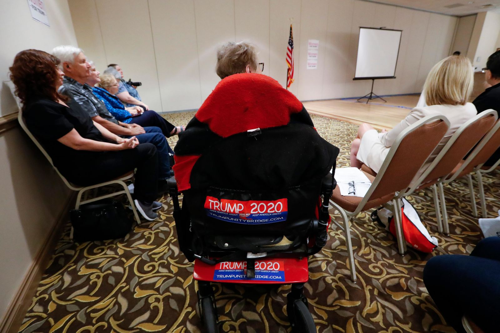 Trump 2020 stickers are shown on a woman's chair during a training session for Women for Trump, An Evening to Empower, in Troy, Mich., Thursday, Aug. 22, 2019. (AP Photo/Paul Sancya)