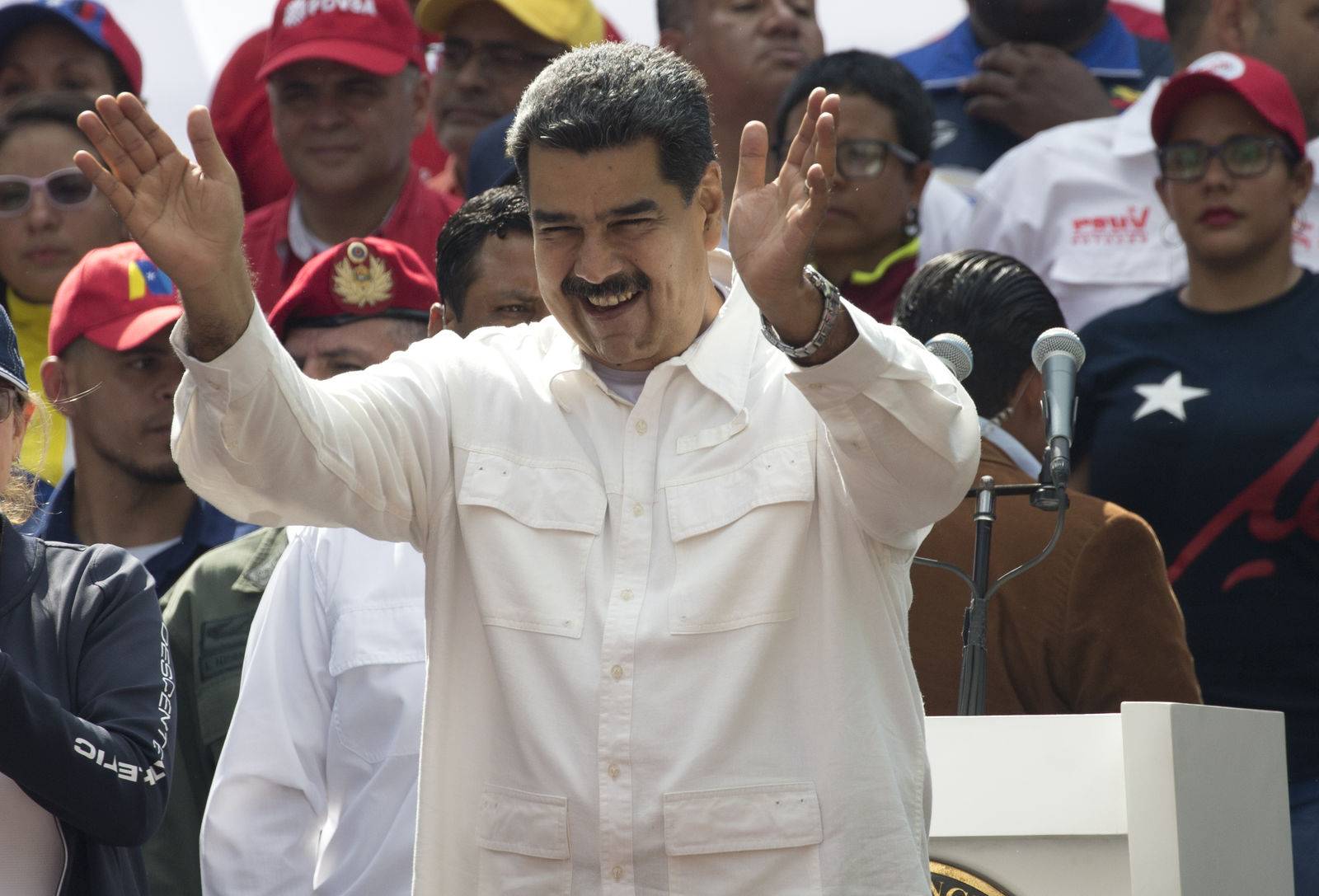"Venezuela's President Nicolas Maduro acknowledges supporters during a government rally in Caracas, Venezuela, Saturday, March 9, 2019.  Demonstrators danced and waved flags on what organizers labeled a ""day of anti-imperialism"" in a show of defiance toward the United States, which has imposed oil sanctions on Venezuela in an attempt to oust the president. (AP Photo/Ariana Cubillos)"