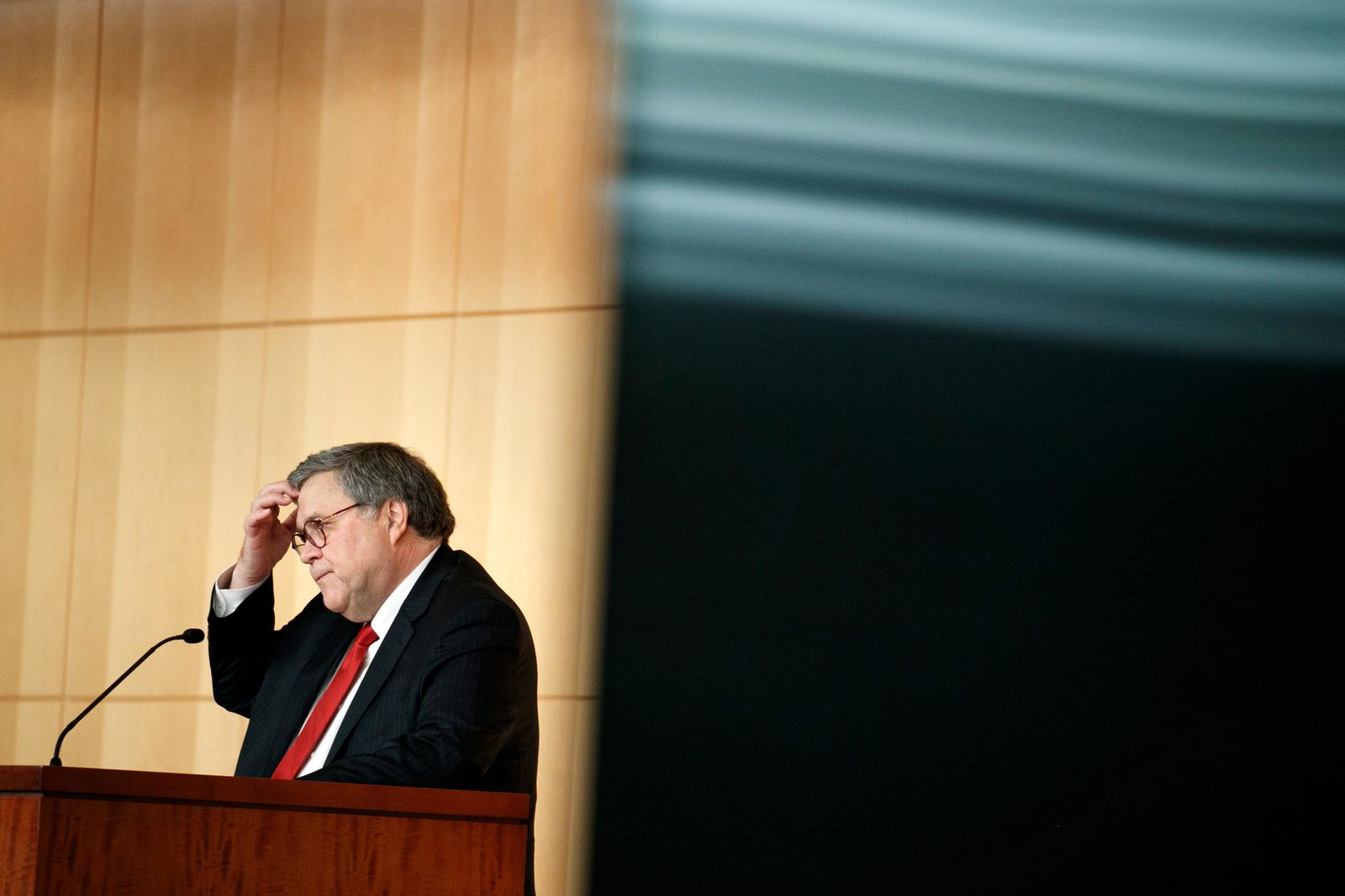 FILE - In this Thursday, Oct. 3, 2019, file photo Attorney General Barr William Barr pauses as he speaks at the Securities and Exchange Commission (SEC) Criminal Coordination Conference at the SEC in Washington. Barr wants Facebook to give law enforcement a way to read encrypted messages sent by users, re-igniting tensions between tech companies and law enforcement. (AP Photo/Jacquelyn Martin, File)
