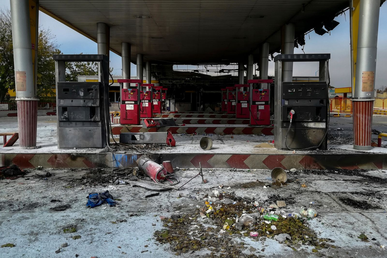 This photo released by the Iranian Students' News Agency, ISNA, shows a gas station that was burned during protests that followed authorities' decision to raise gasoline prices, in Tehran, Iran, Sunday, Nov. 17, 2019. (Abdolvahed Mirzazadeh/ISNA via AP)