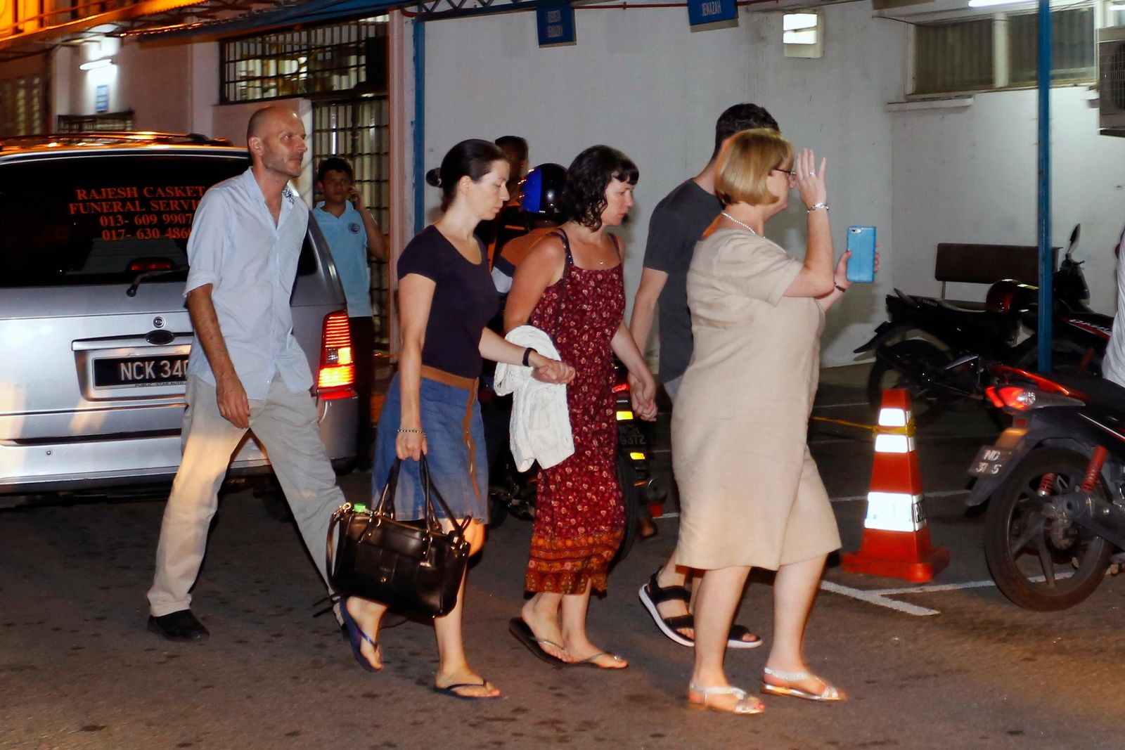 Family members of missing British girl Nora Anne Quoirin arrive at a hospital morgue in Seremban, Negeri Sembilan, Malaysia, Tuesday, Aug. 13, 2019.{ } (AP Photo/Lai Seng Sin)